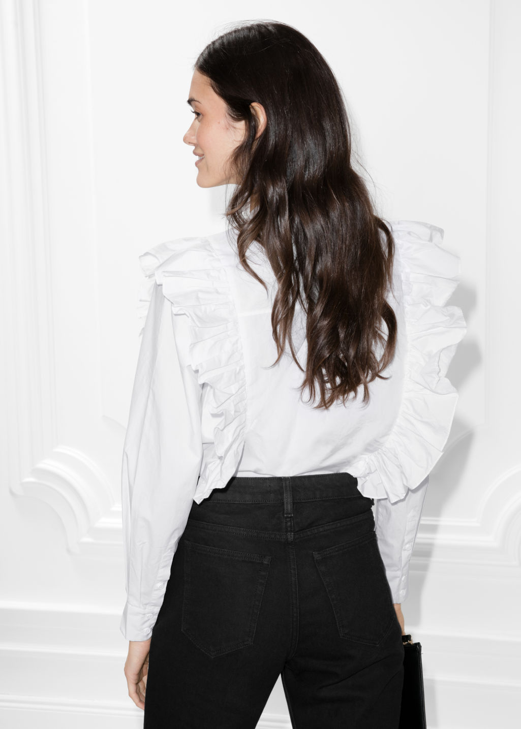 Model back image of Stories frills blouse with button closure in white