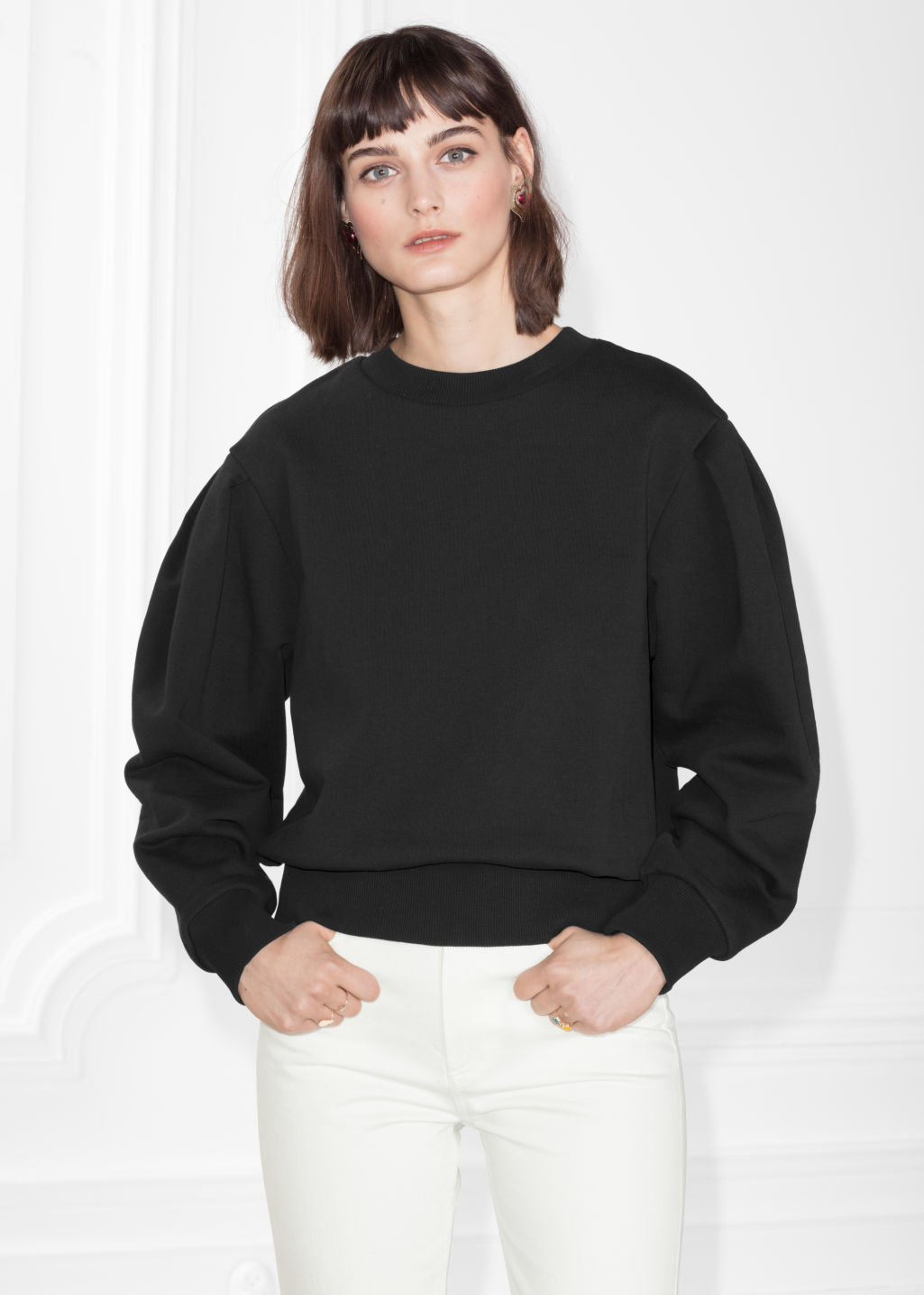 Model front image of Stories puff sleeve cotton sweatshirt in black