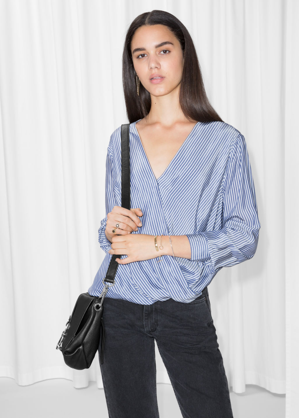 Model front image of Stories wrap top in blue