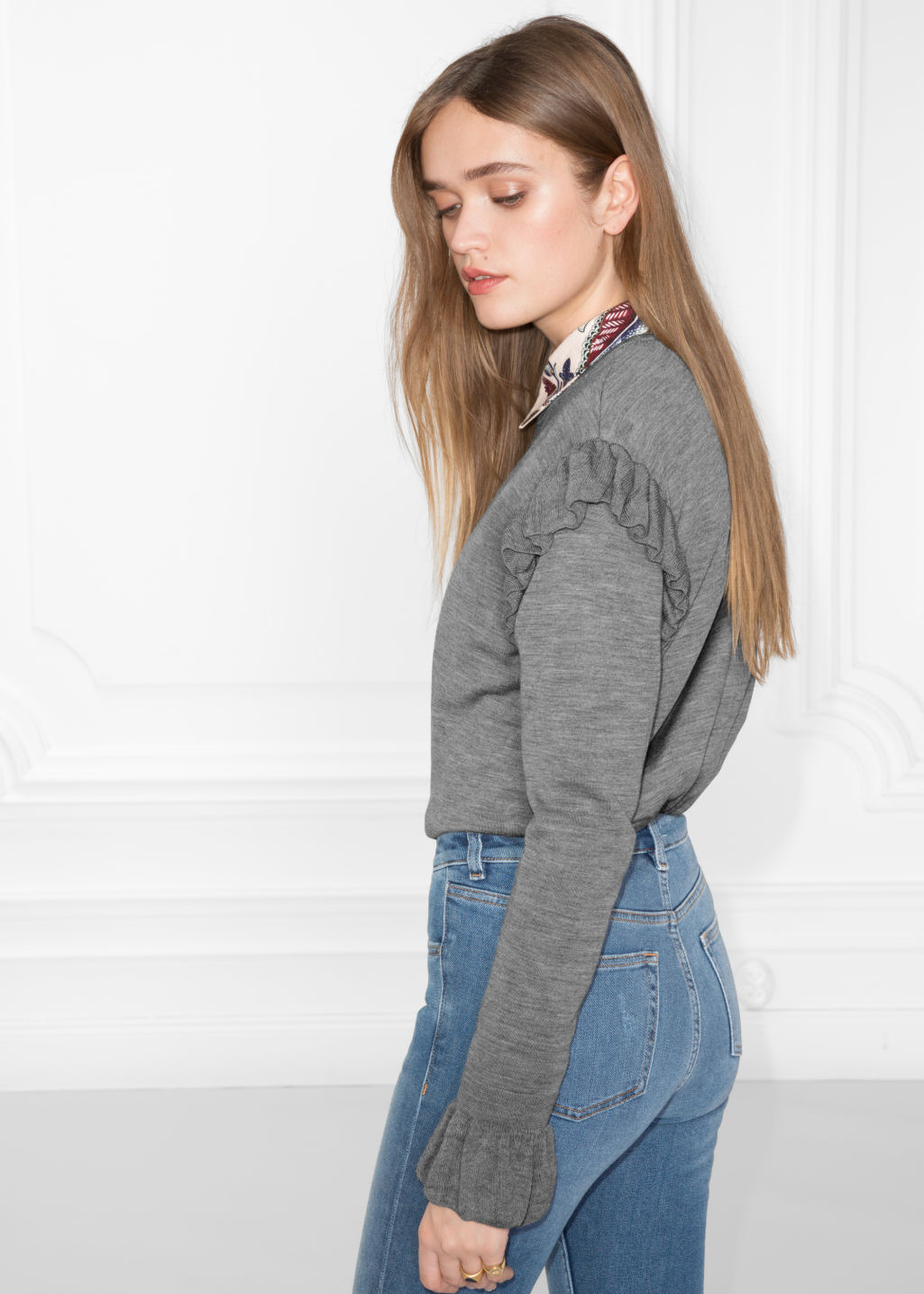 Model back image of Stories frill merino wool sweater in grey