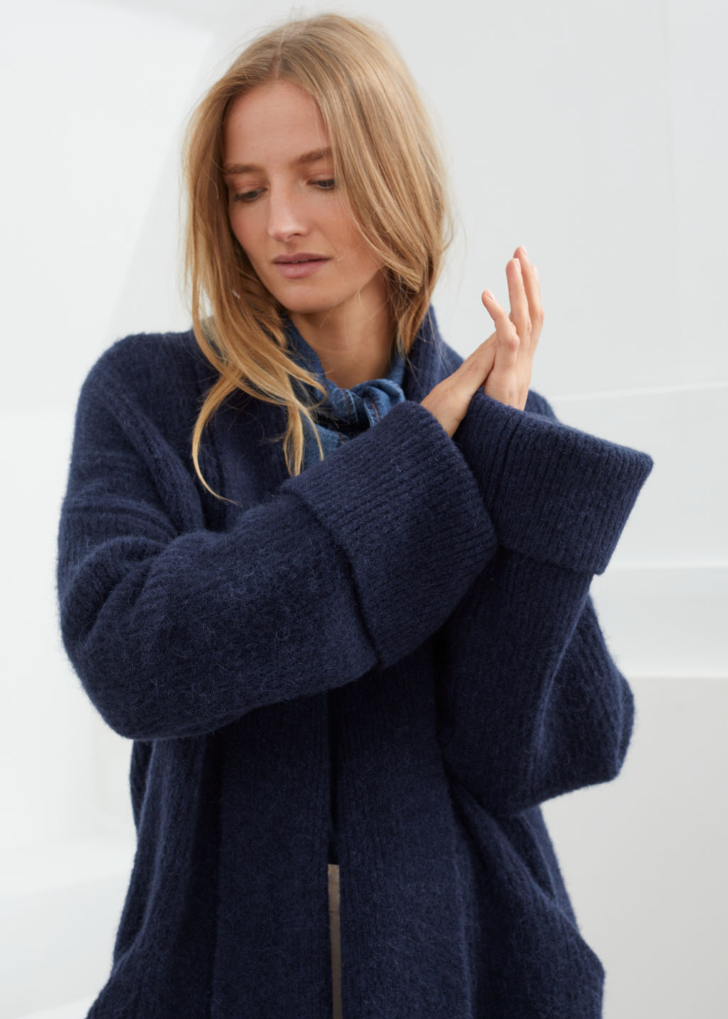 Model front image of Stories rib knit cardigan in blue