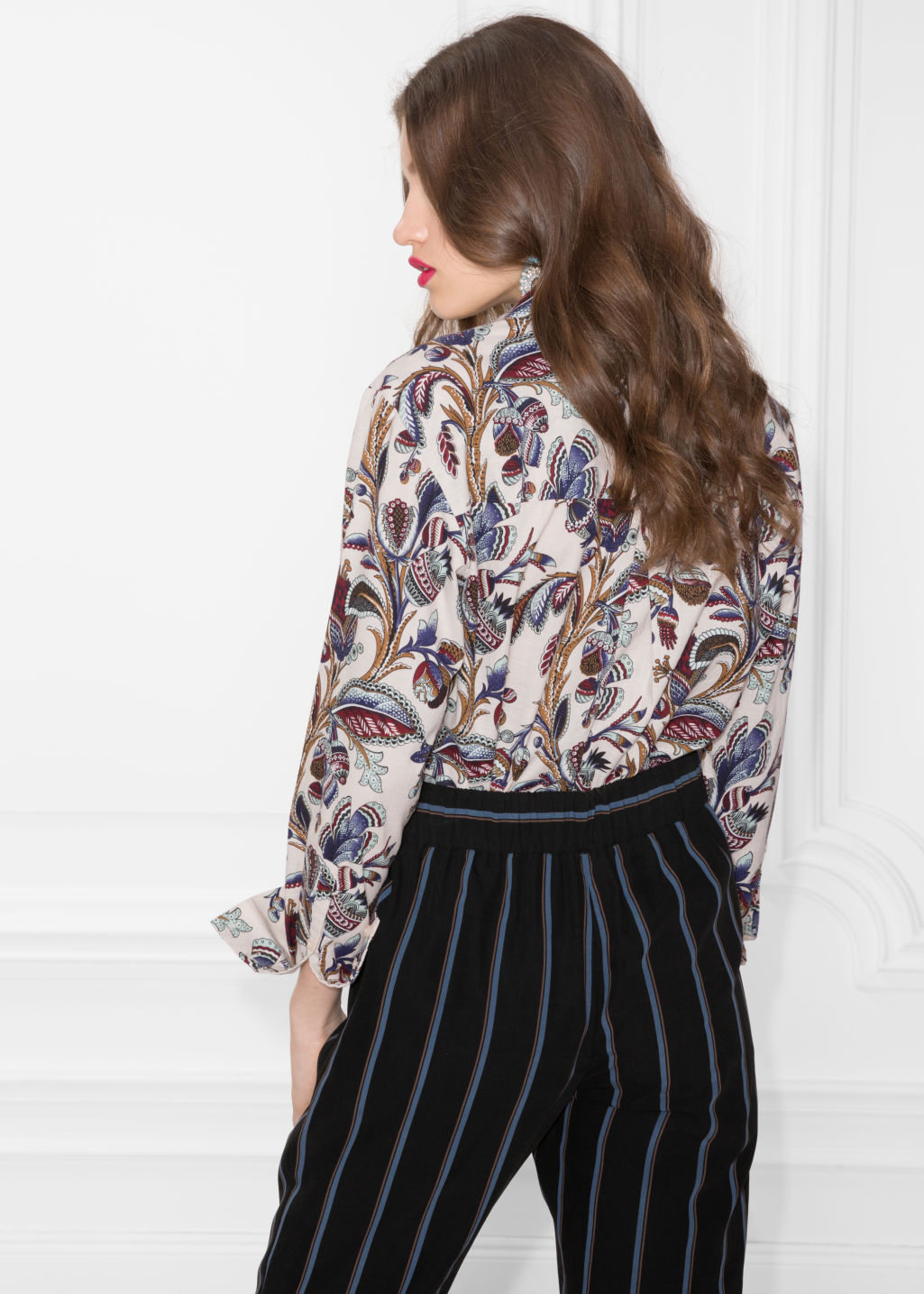 Model back image of Stories climbing floral shirt in beige