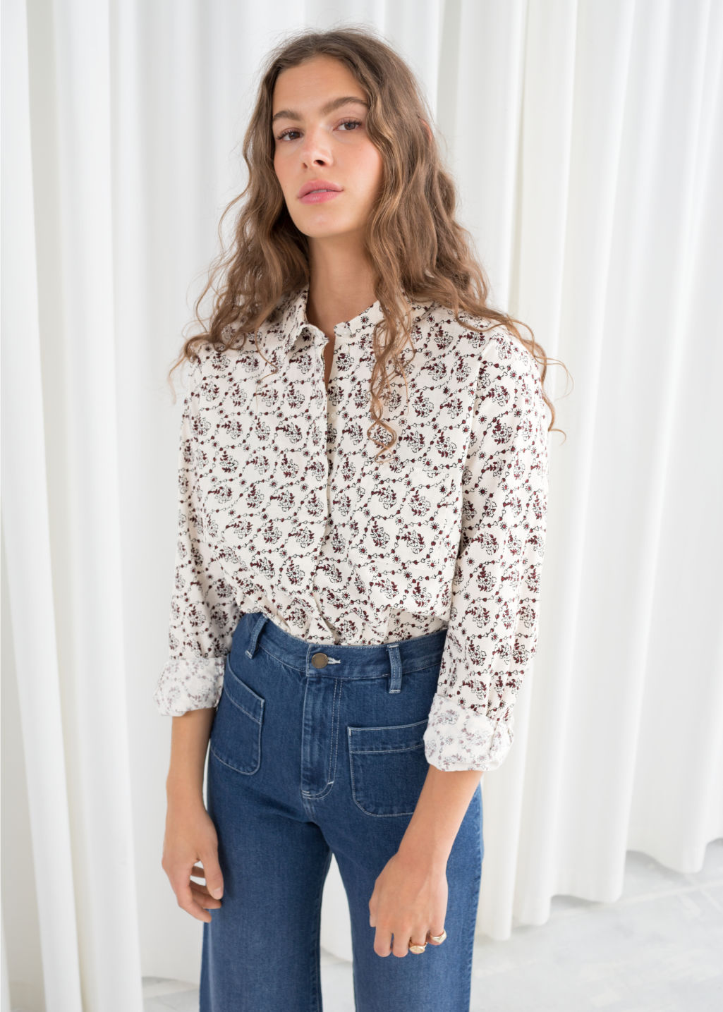 Model front image of Stories climbing floral shirt in white