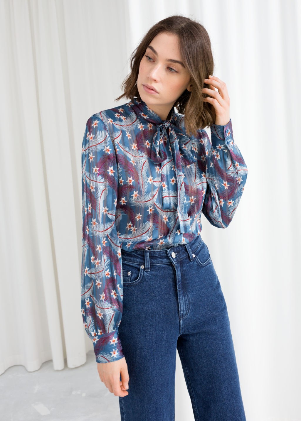 8e9a8d1c5358 Model front image of Stories printed pussy bow blouse in blue ...