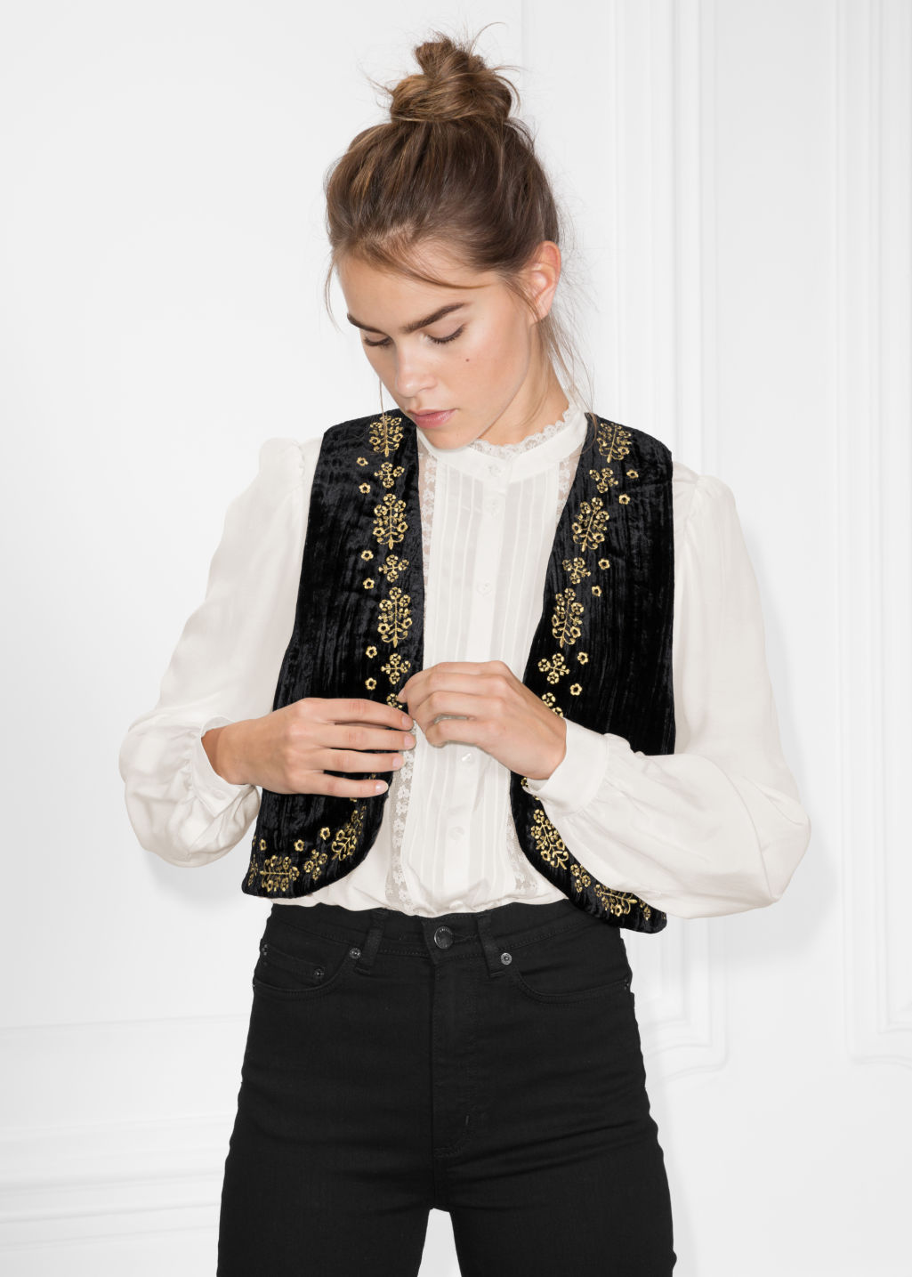 Model front image of Stories velveteen vest in black