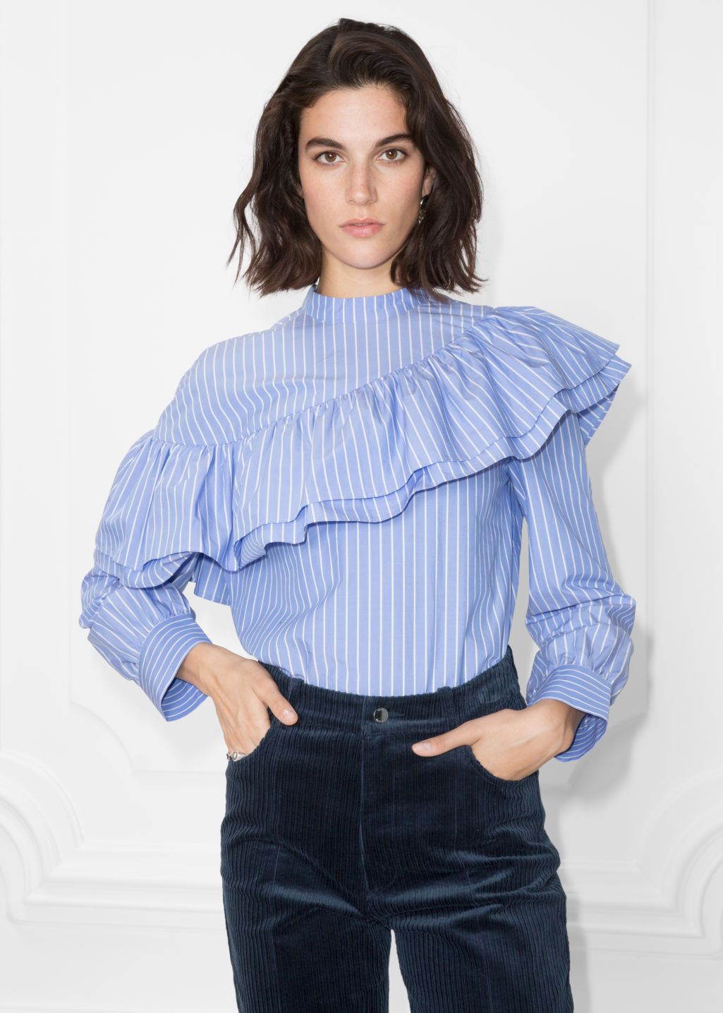 Model front image of Stories striped cotton shirt in blue