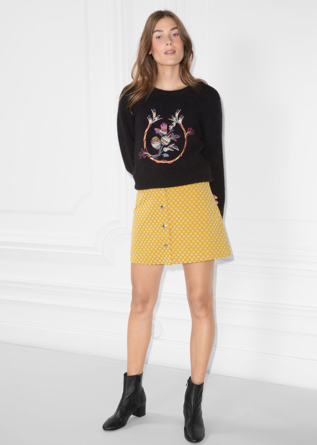 Model front image of Stories mini skirt with button closure in yellow