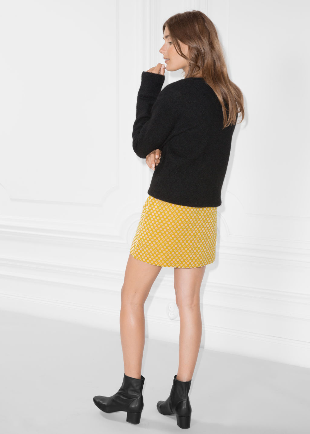 Model back image of Stories mini skirt with button closure in yellow