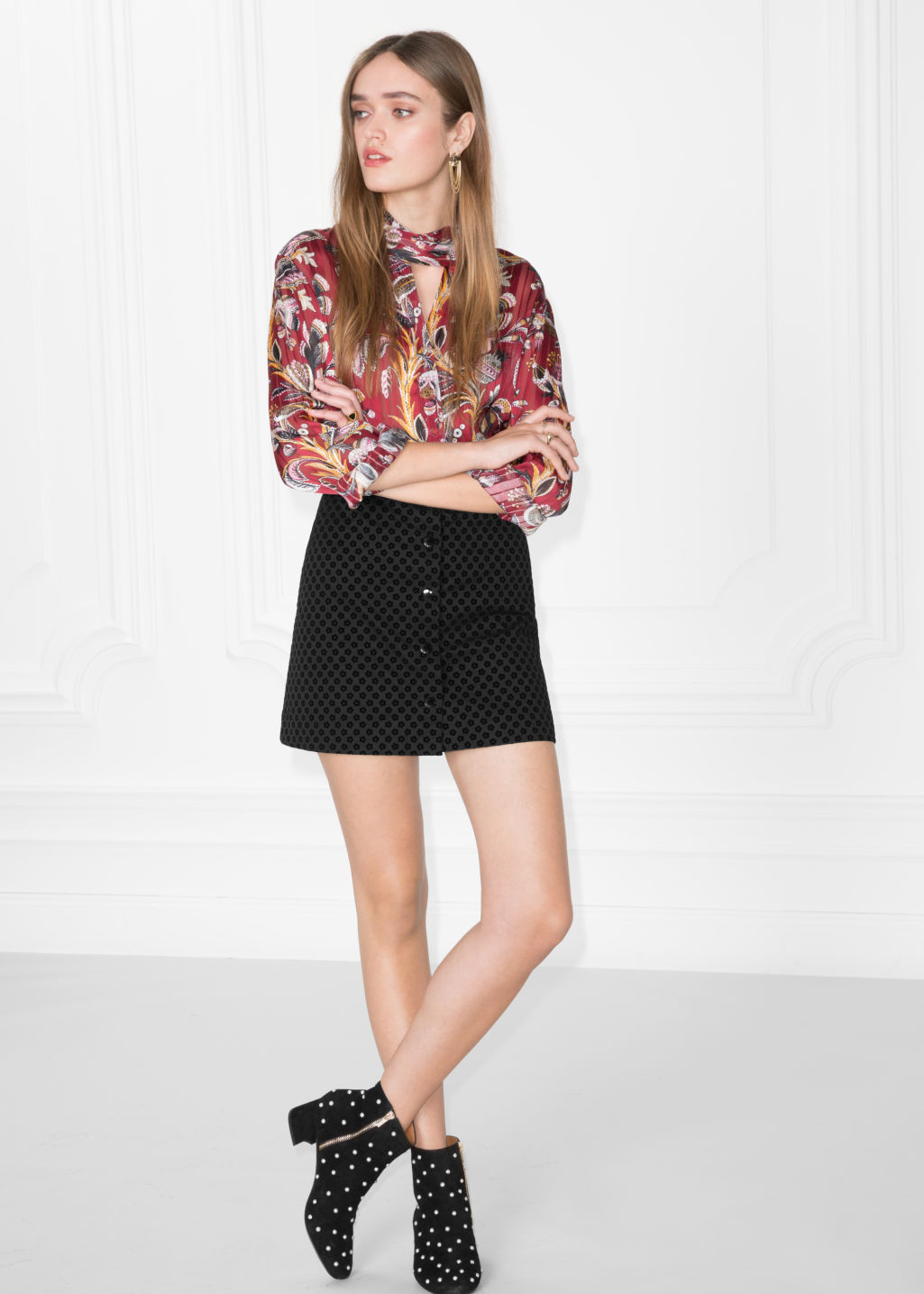 Model front image of Stories mini skirt with button closure in black