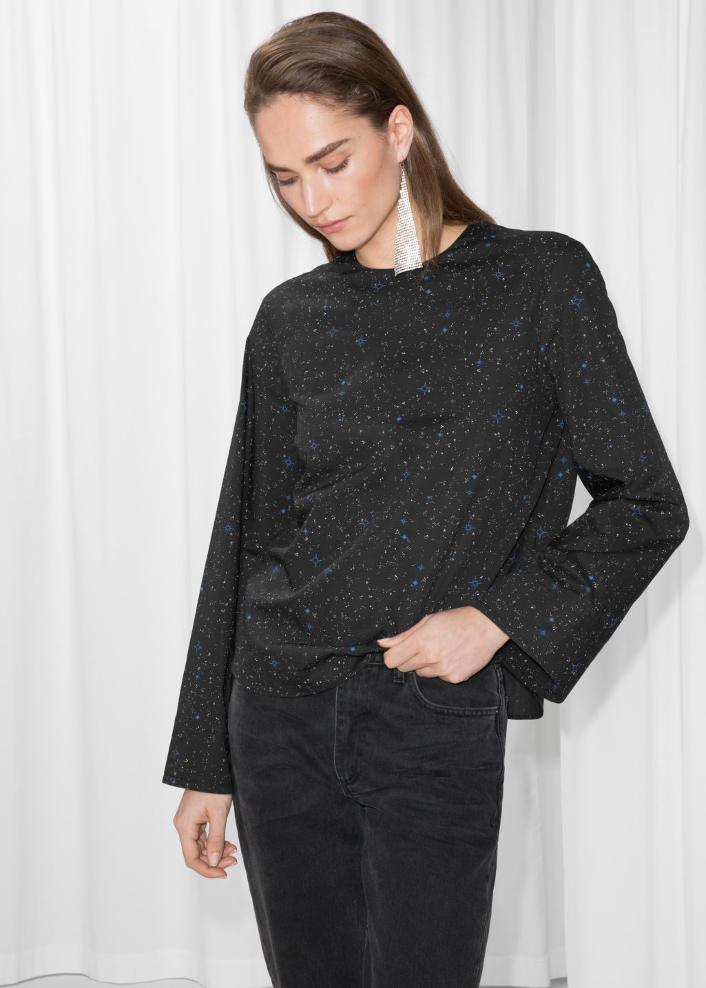 Model front image of Stories starry print blouse in black