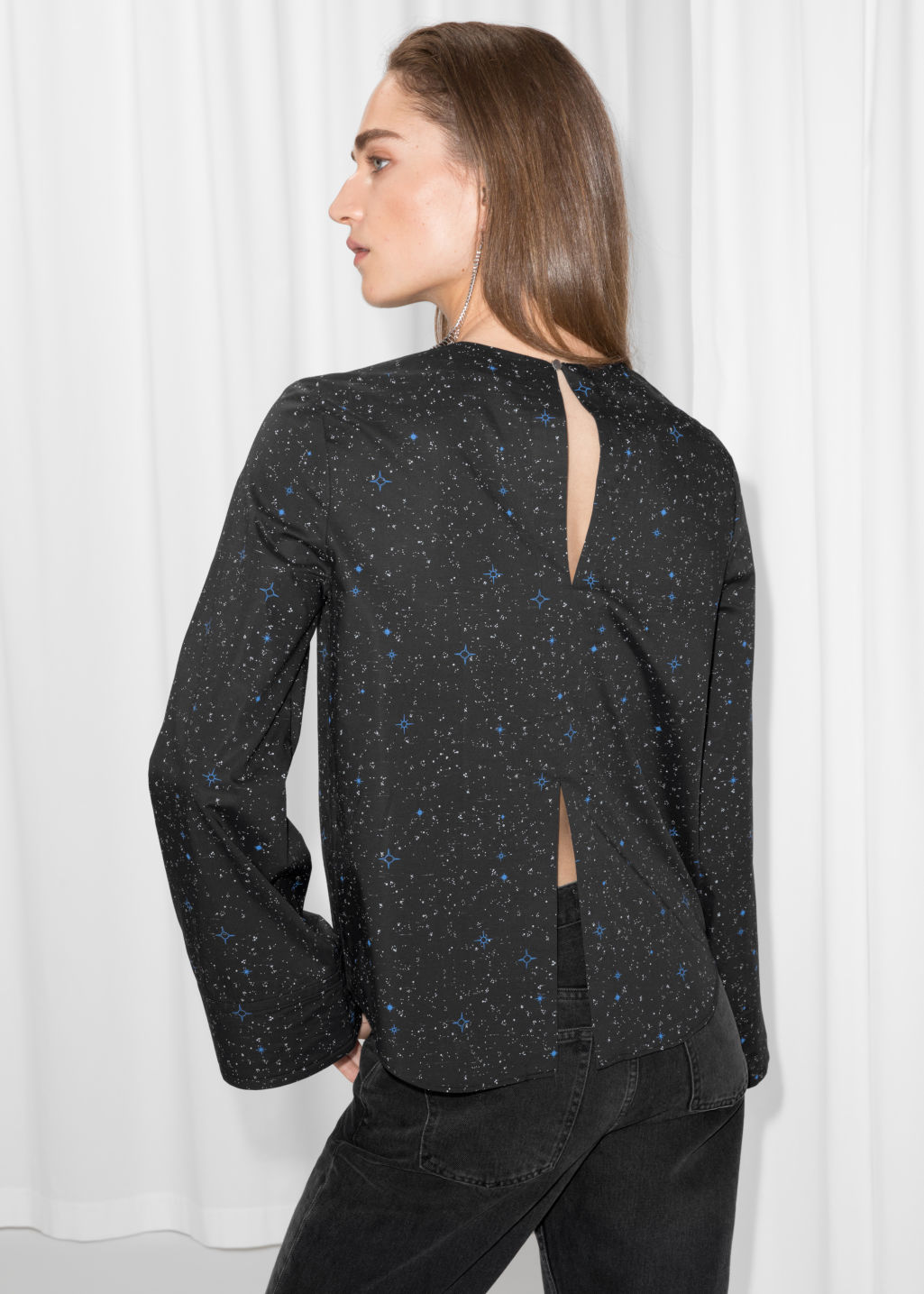 Model back image of Stories starry print blouse in black