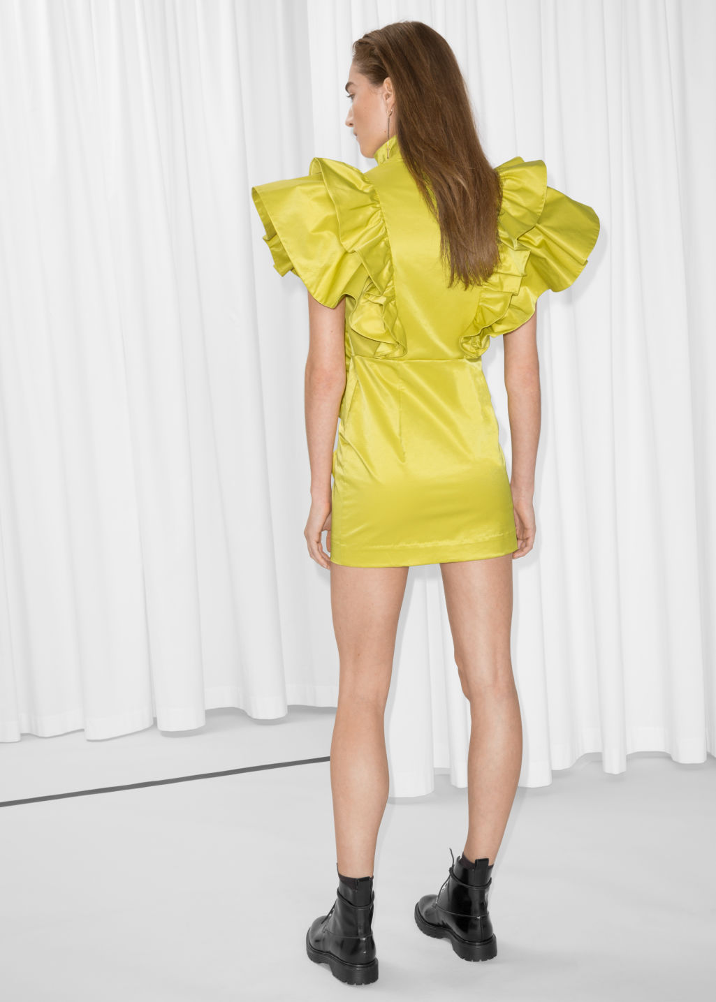 Model back image of Stories frill mini dress in yellow