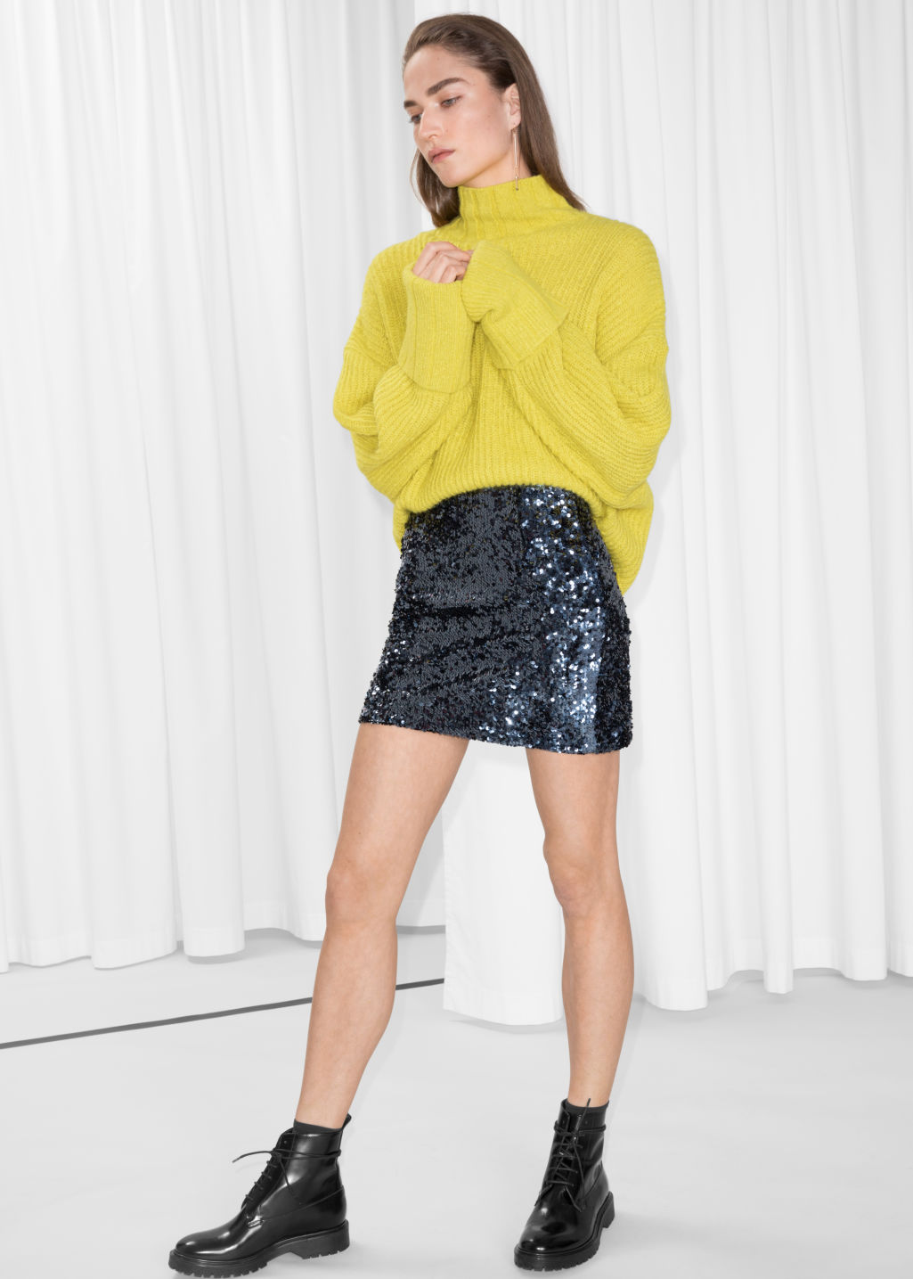 Model front image of Stories sequin mini skirt in blue
