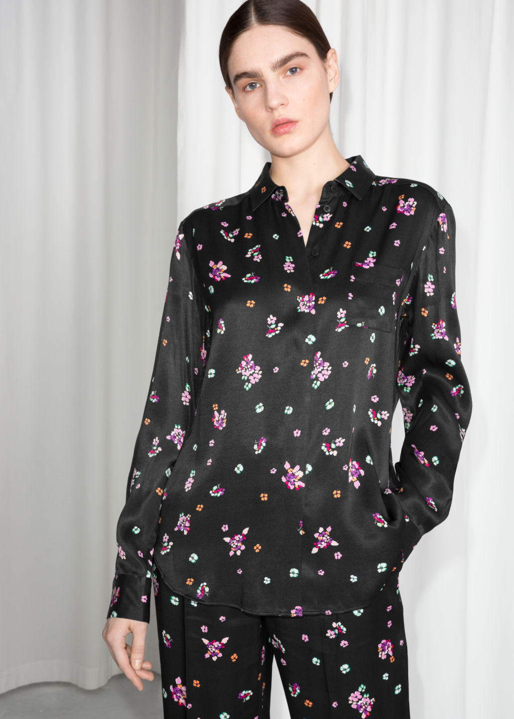 Model front image of Stories petit flower shirt in black