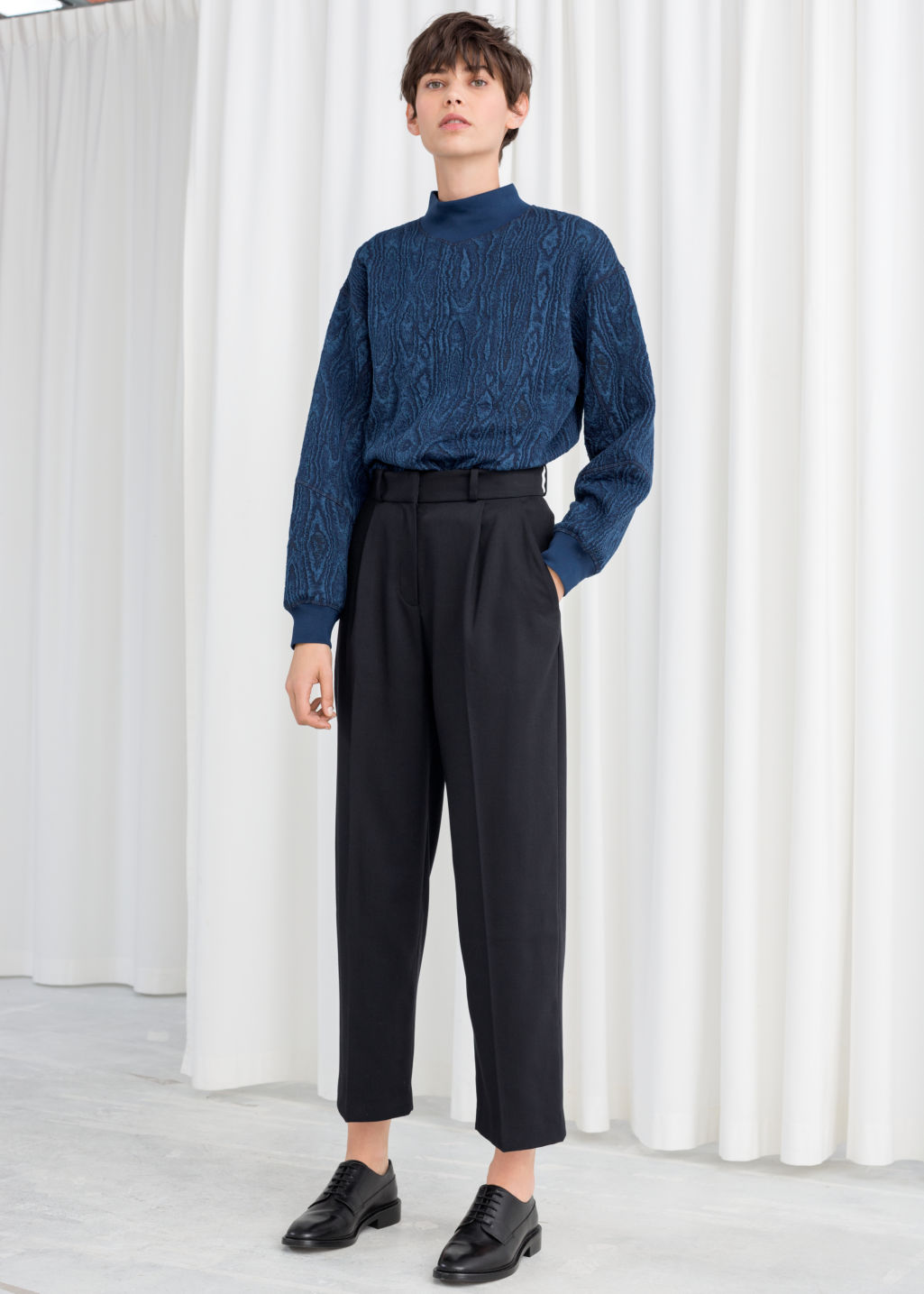 Model front image of Stories creased trousers in blue