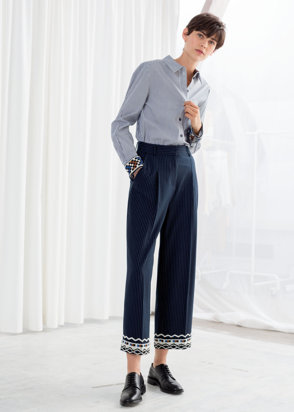 Model front image of Stories tailored straight trousers in blue