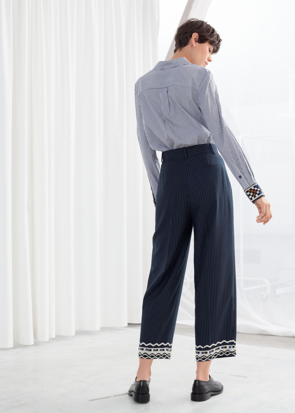 Model back image of Stories tailored straight trousers in blue