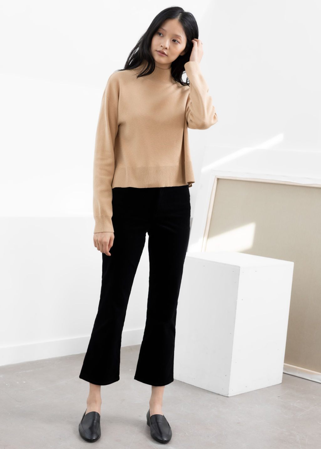 Model front image of Stories kick flare corduroy trousers in black
