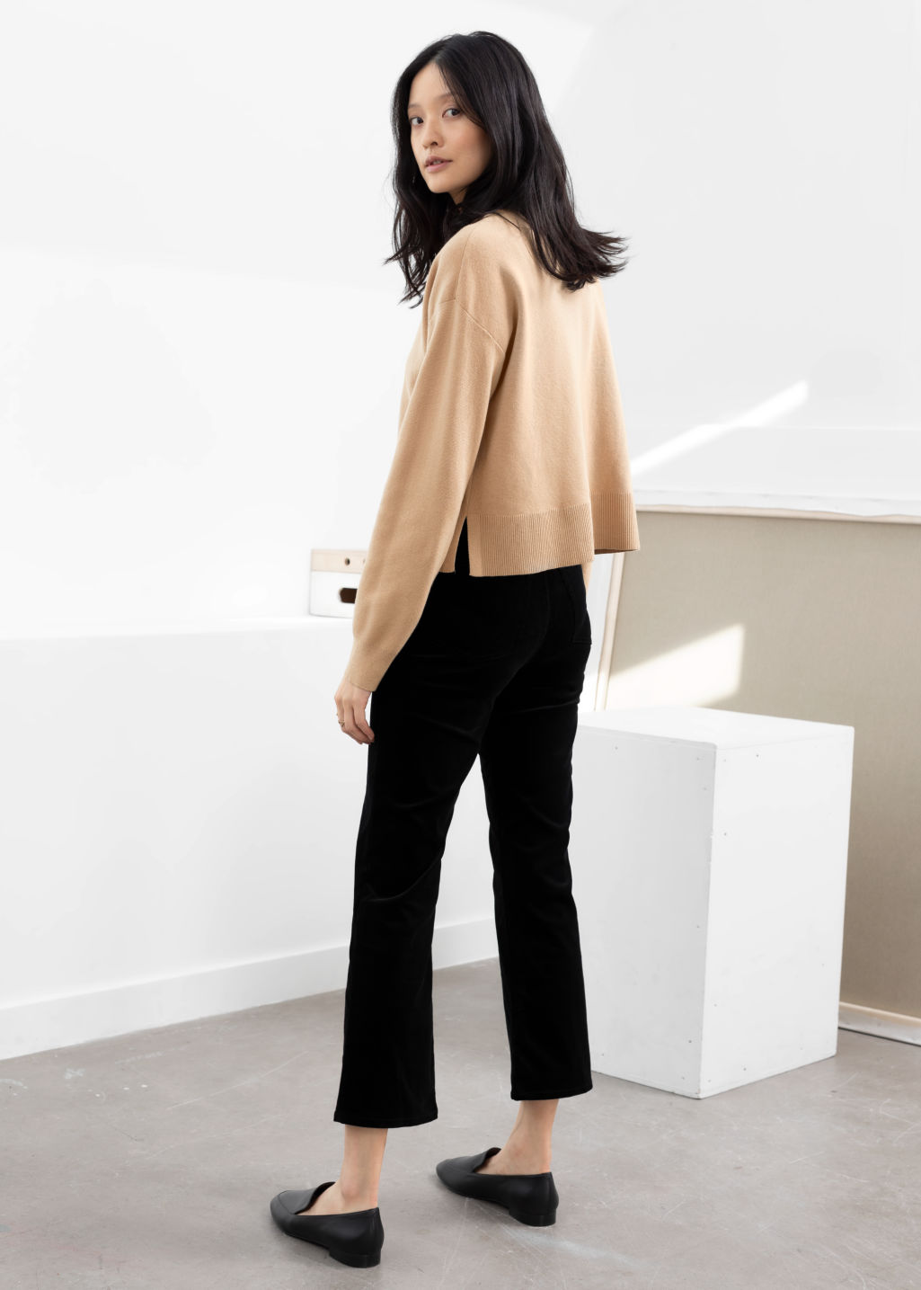 Model back image of Stories kick flare corduroy trousers in black