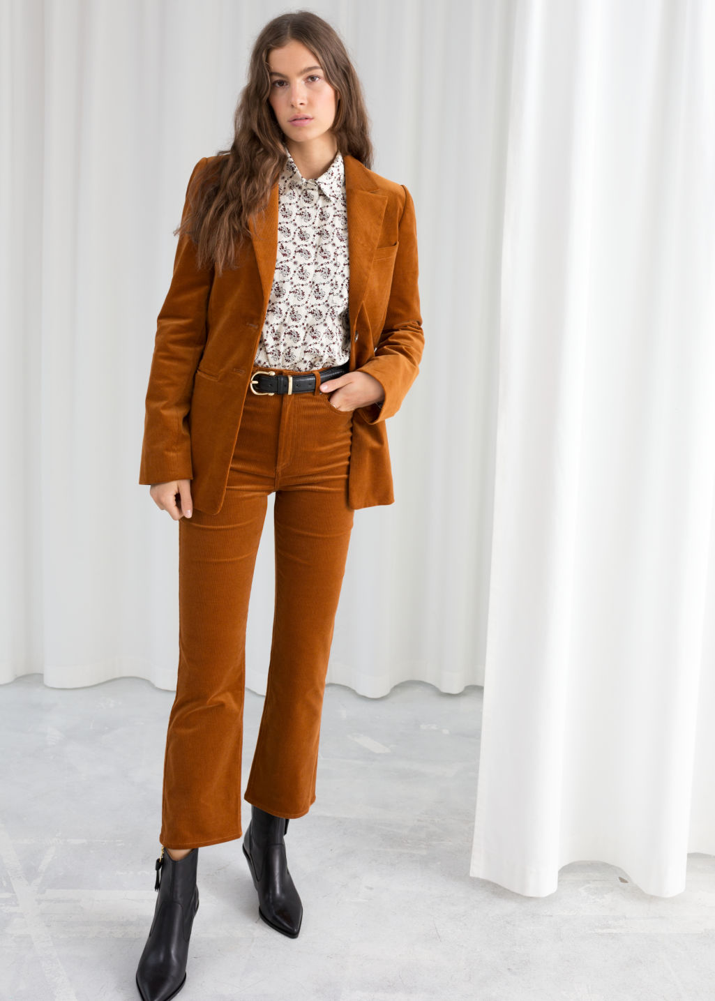 Model front image of Stories kick flare corduroy trousers in orange