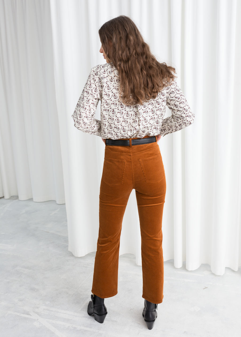Model back image of Stories kick flare corduroy trousers in orange