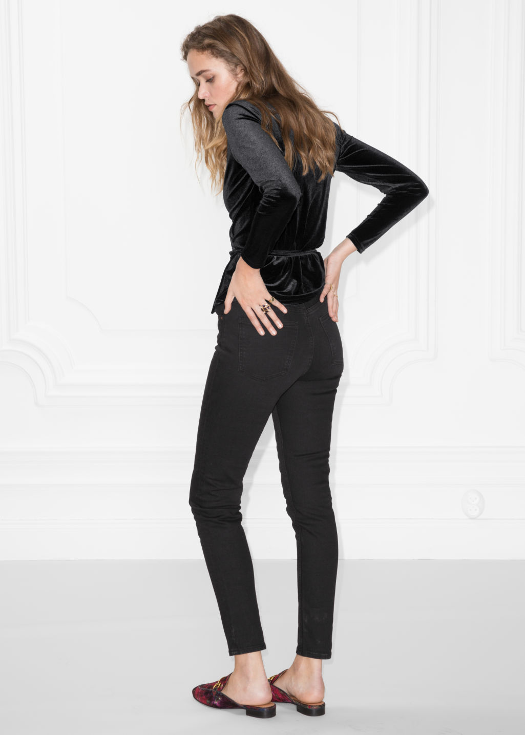 Model back image of Stories slim-fit denim jeans in black