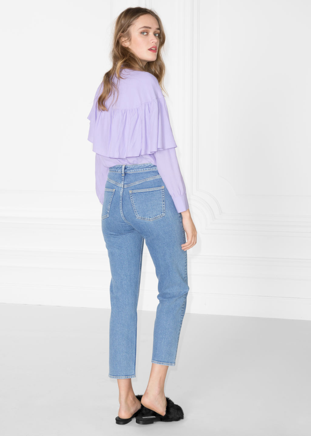 Model back image of Stories front slit cropped denim in blue