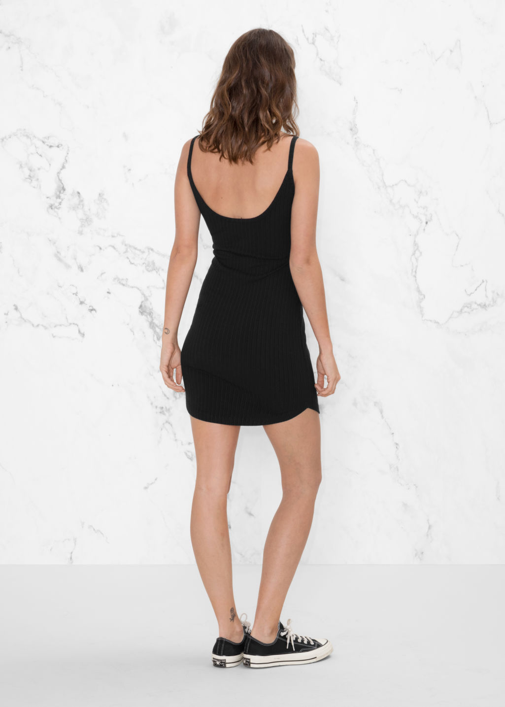 Model back image of Stories ribbed dress in black
