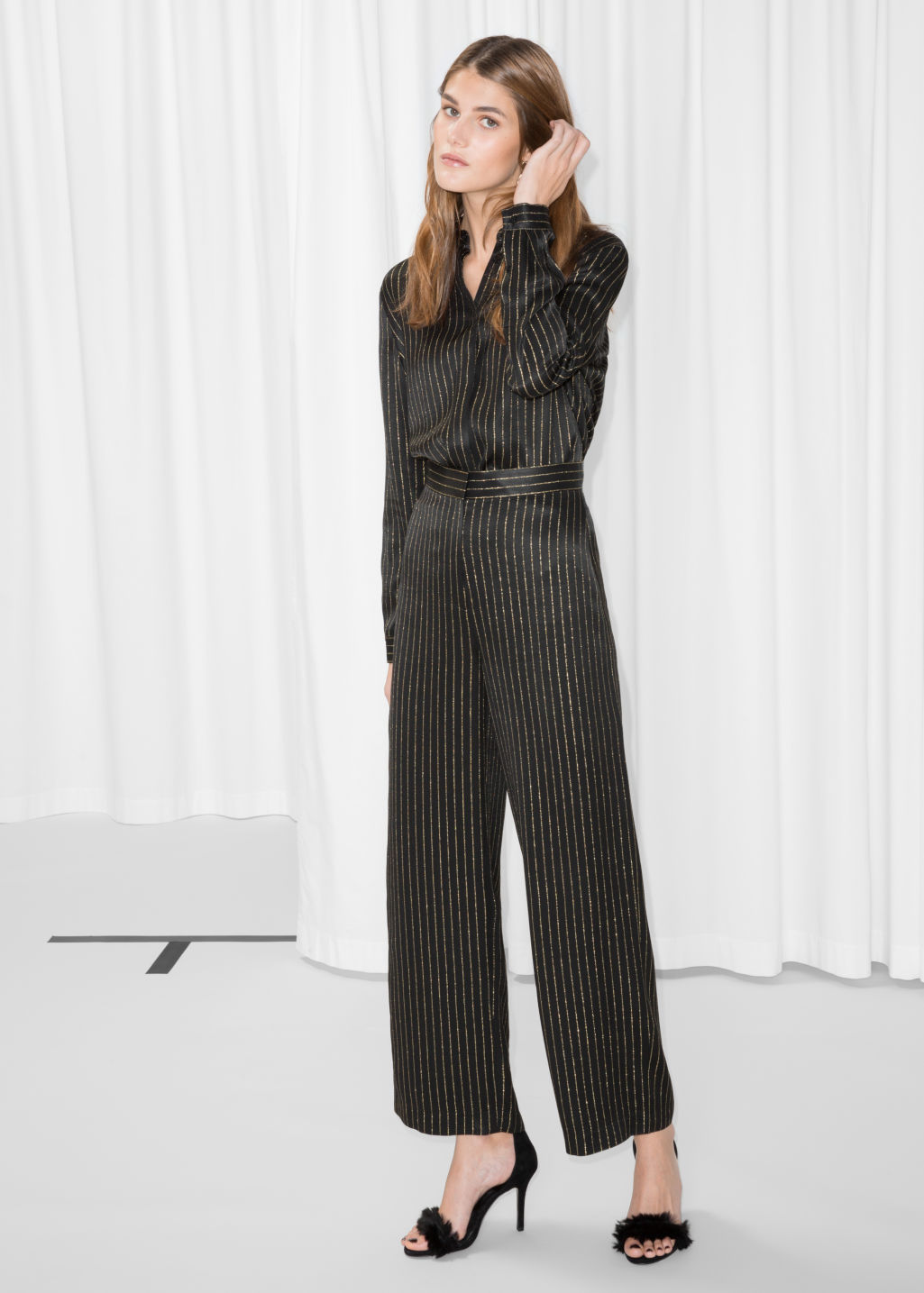 Model front image of Stories gold-tone pinstripe trousers in black