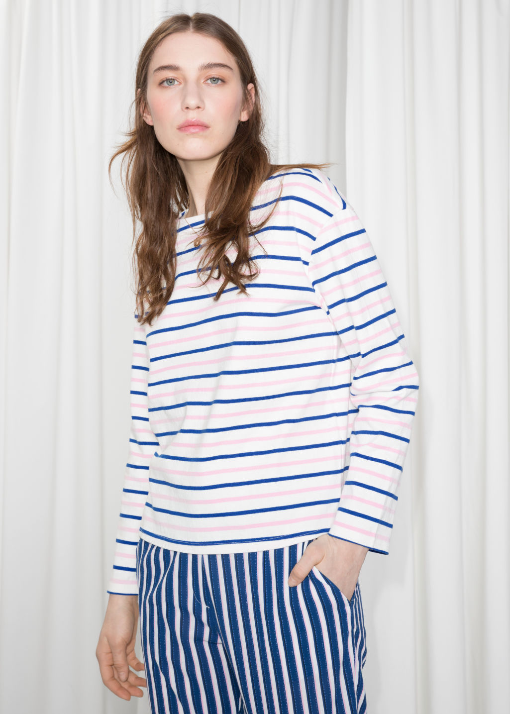 Model front image of Stories stripe top in pink
