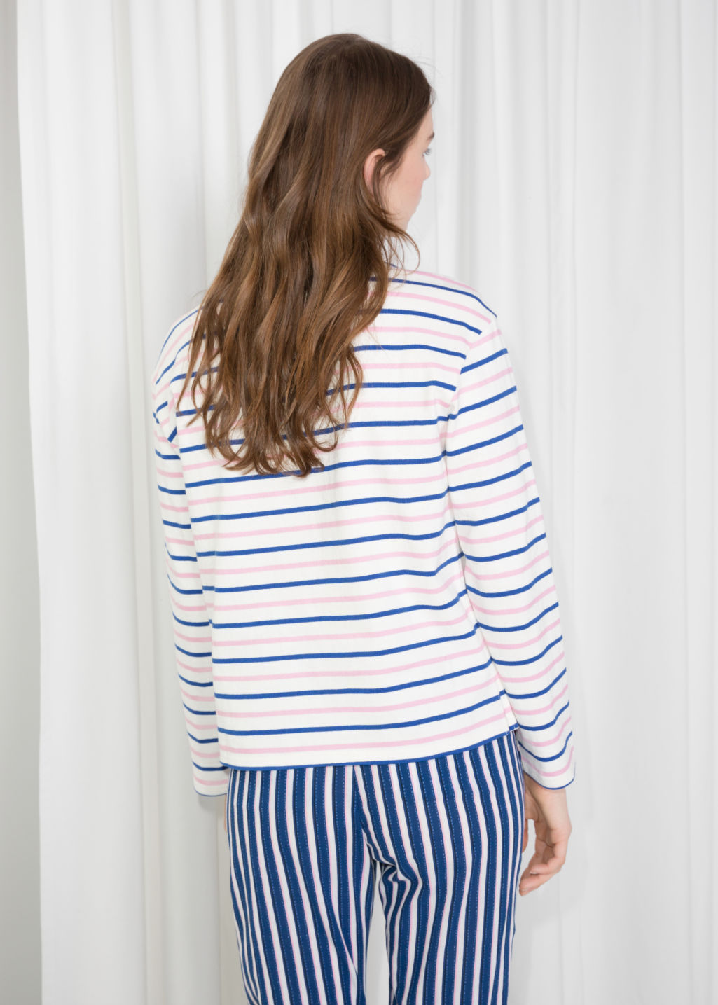 Model back image of Stories stripe top in pink
