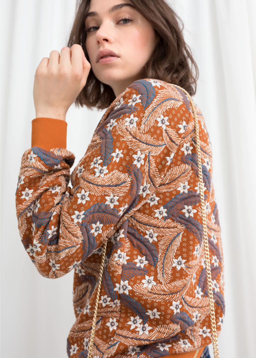 Model front image of Stories vintage floral sweater in orange