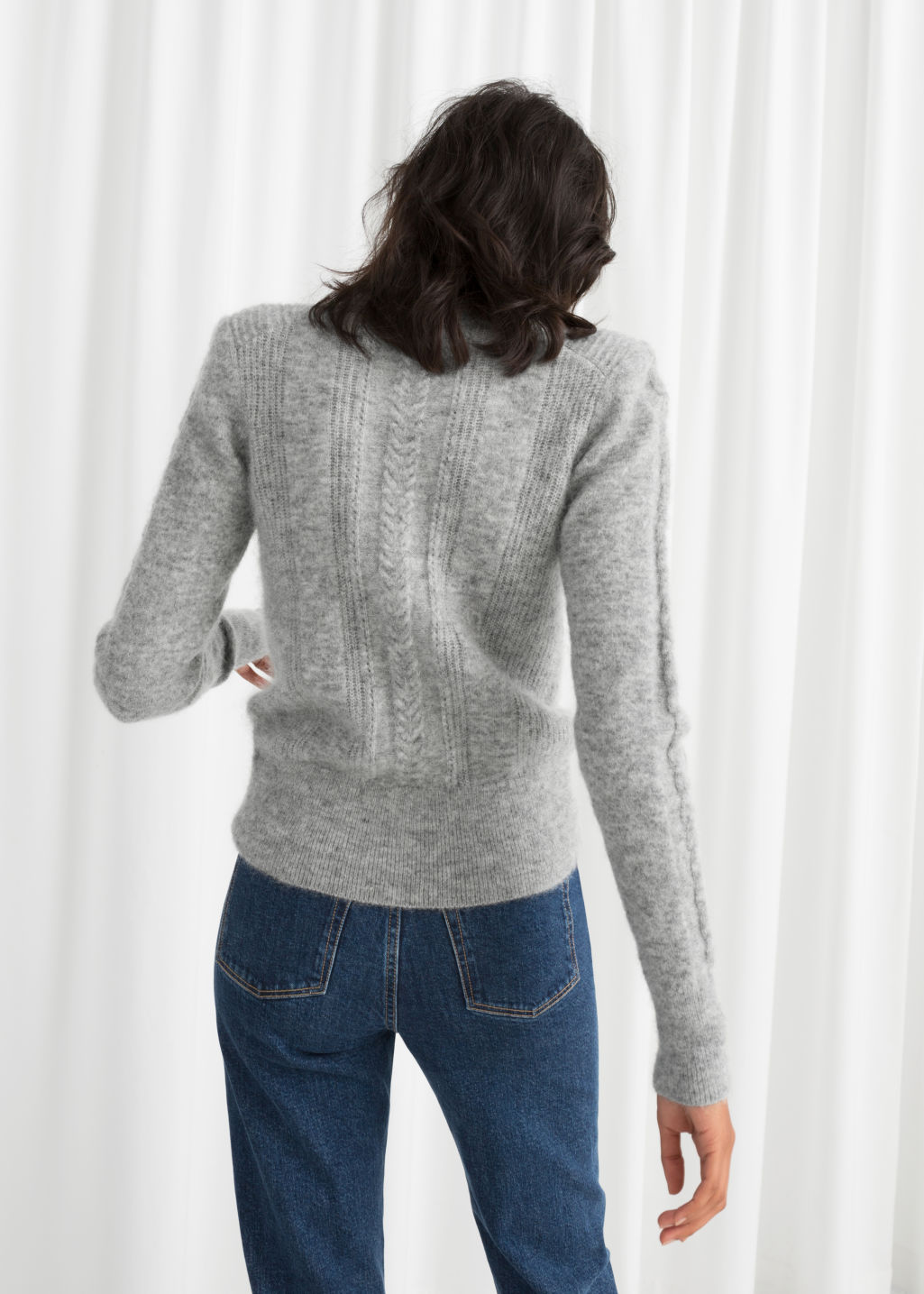 Model back image of Stories cable knit sweater in grey