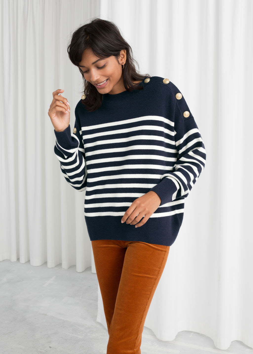 Model front image of Stories stripe knit sweater in blue