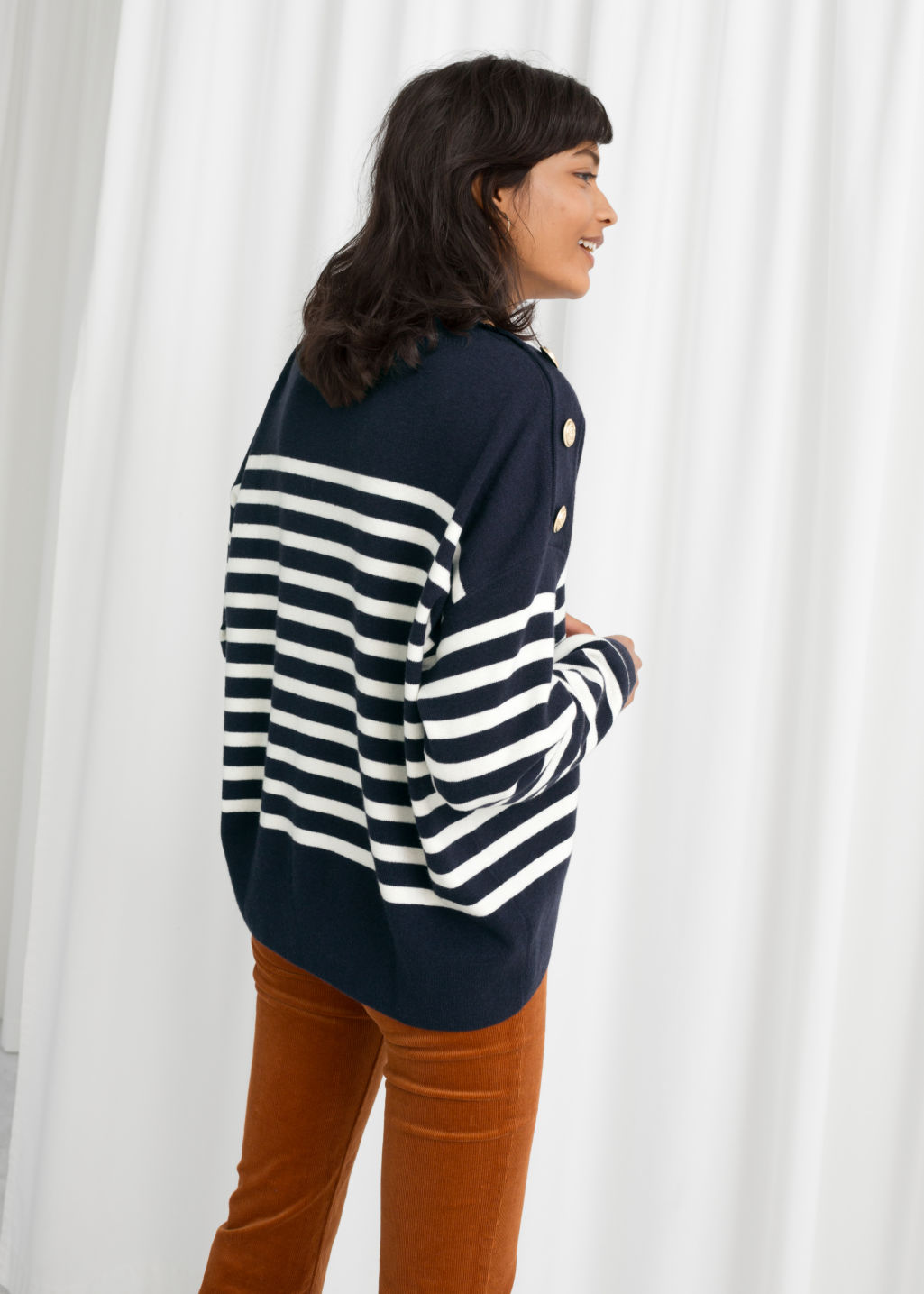 Model back image of Stories stripe knit sweater in blue