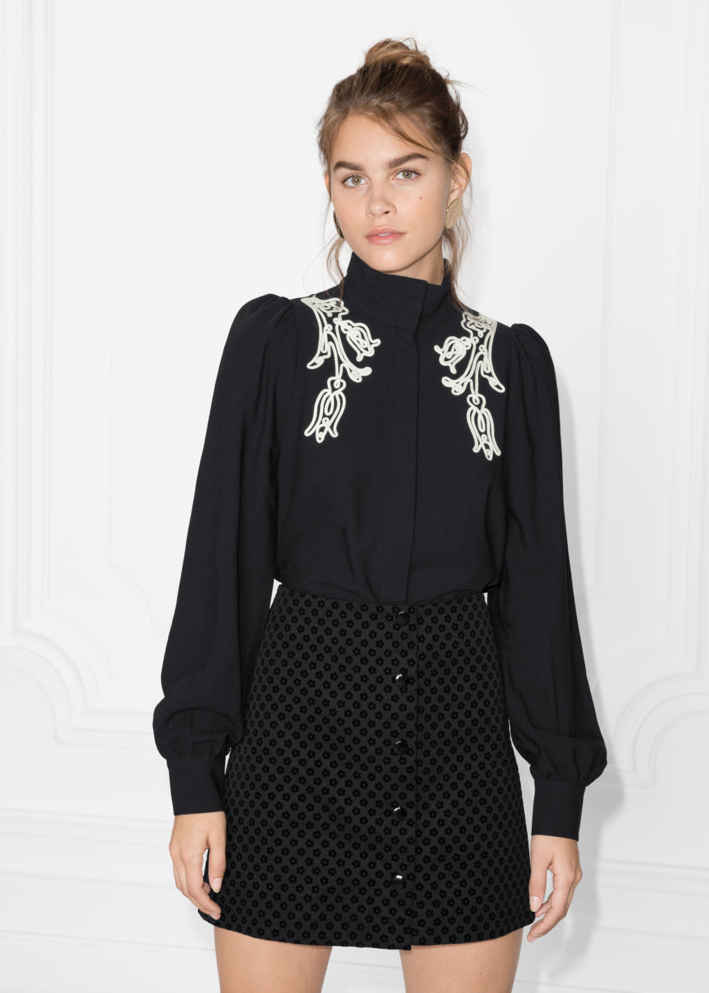 Model front image of Stories floral embroidered blouse in black