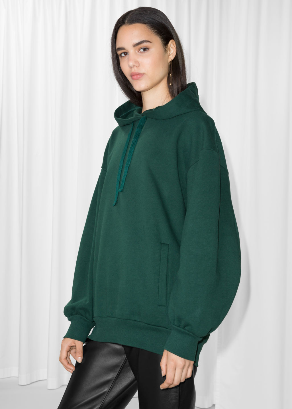 Model front image of Stories oversized sweatshirt in green