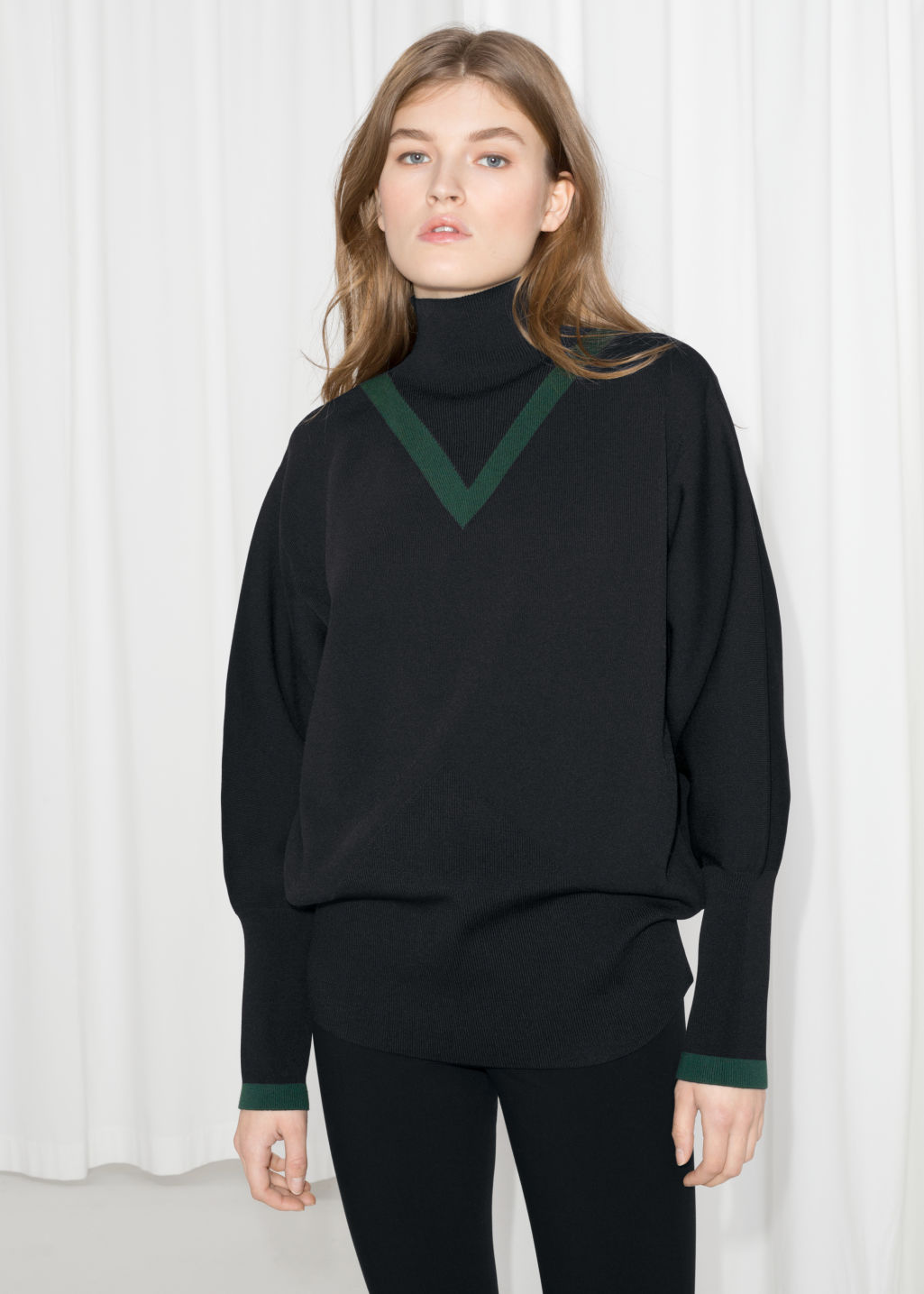 Model front image of Stories high neck v-knit sweater in black