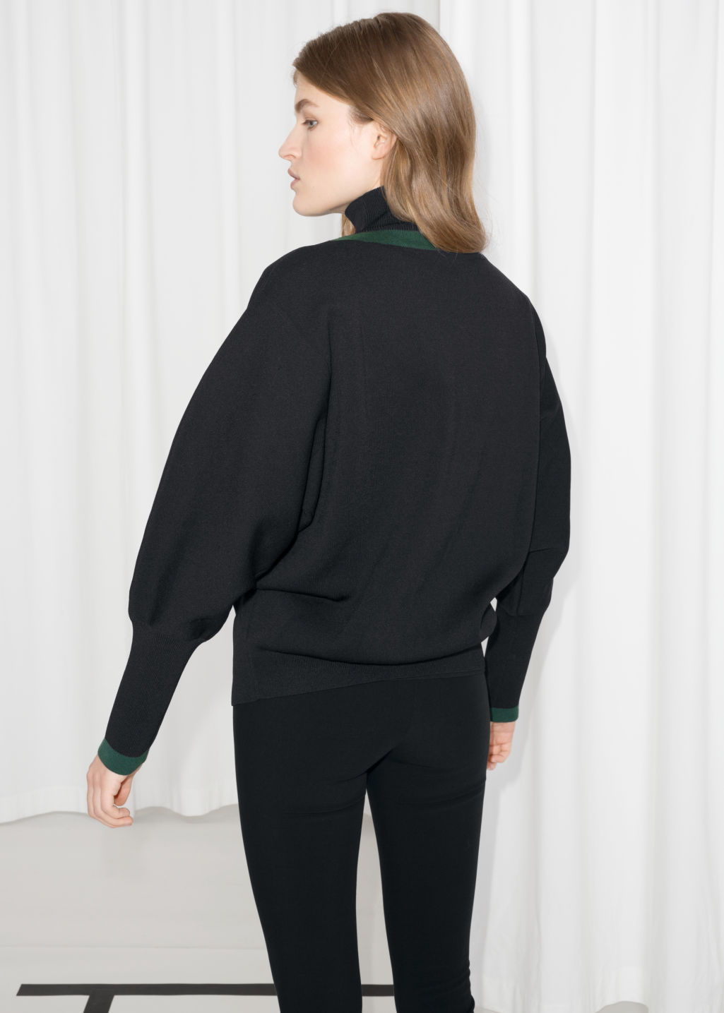 Model back image of Stories high neck v-knit sweater in black