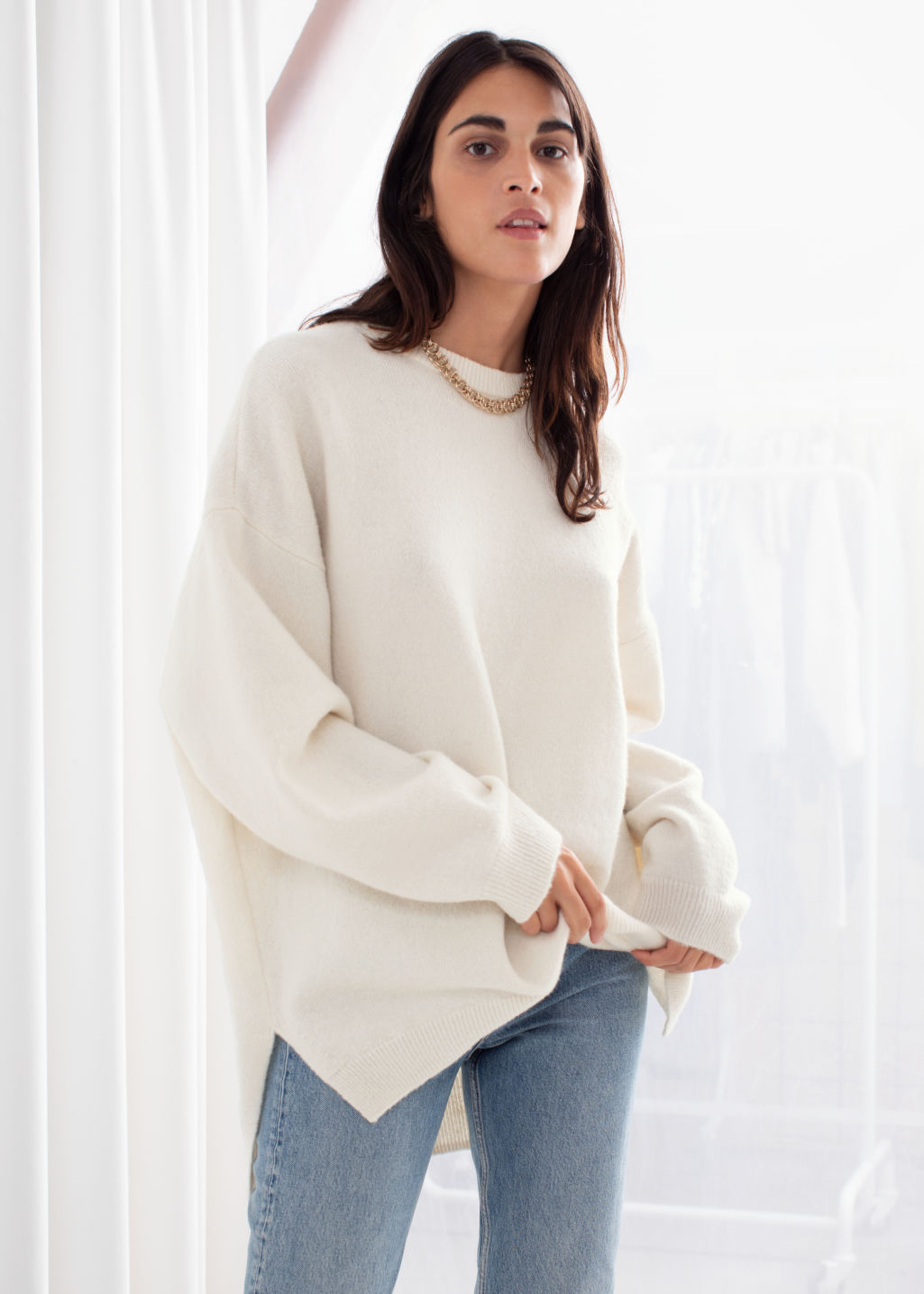 Model front image of Stories wool sweater in beige