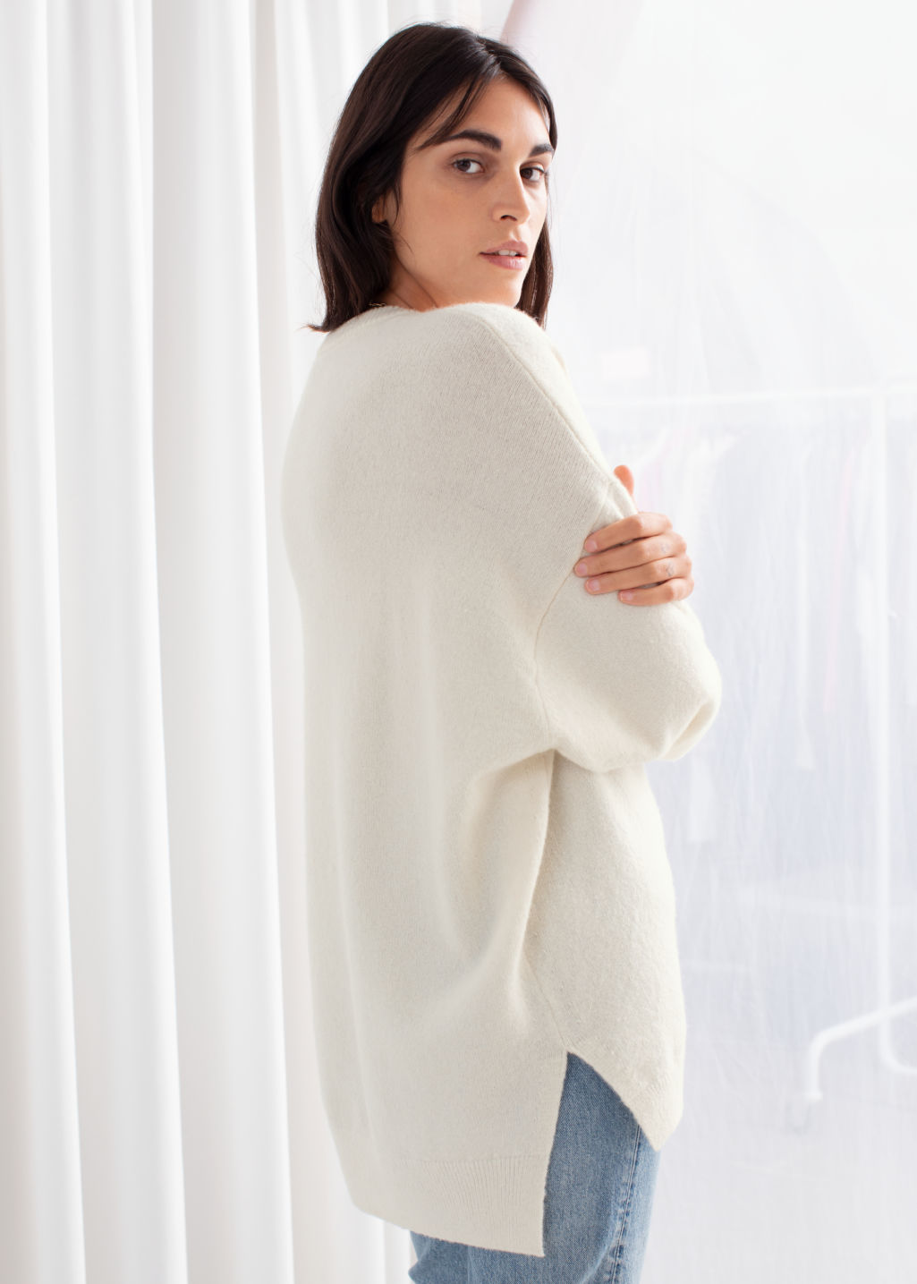 Model back image of Stories wool sweater in beige