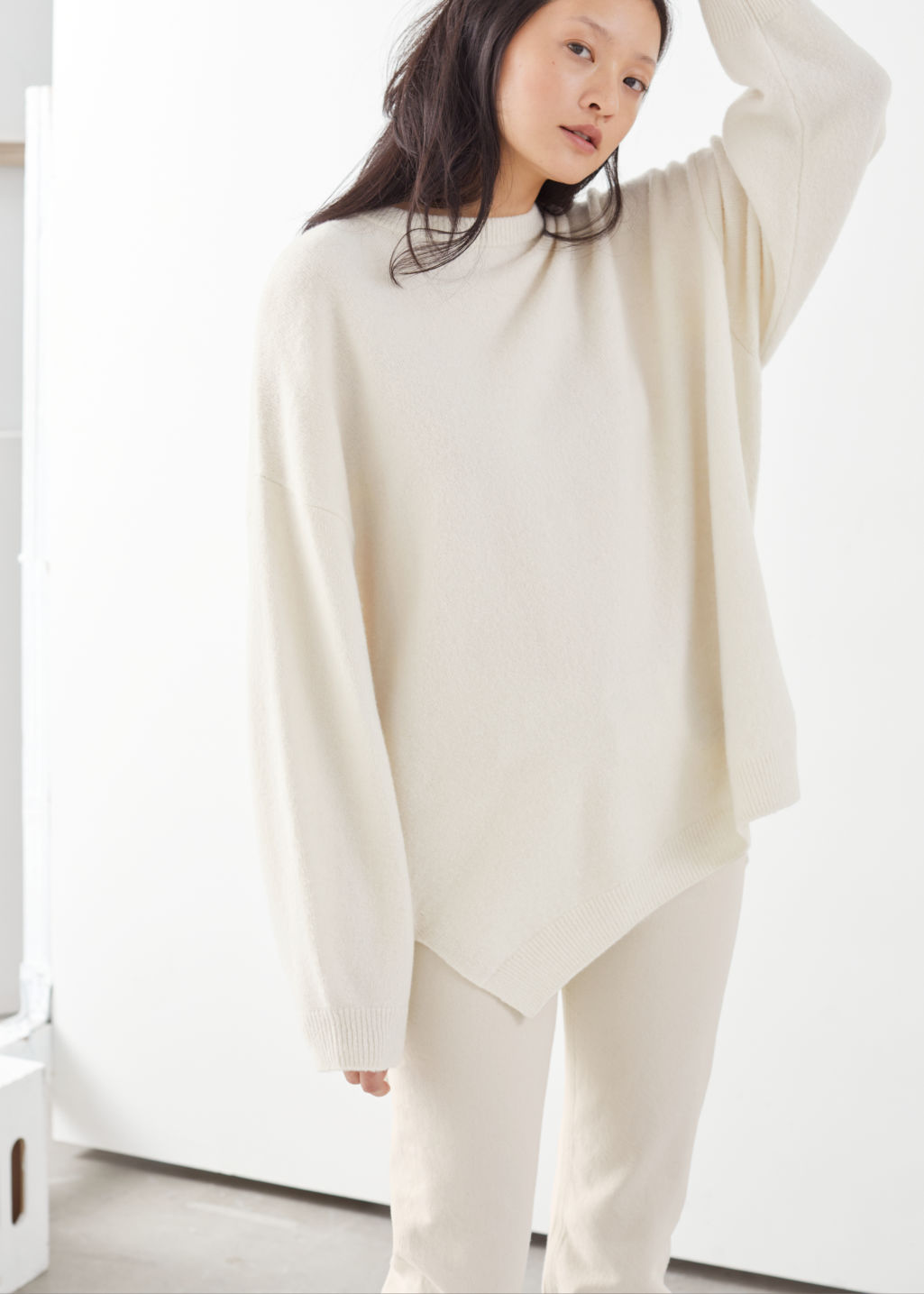 Model front image of Stories oversized wool blend sweater in beige