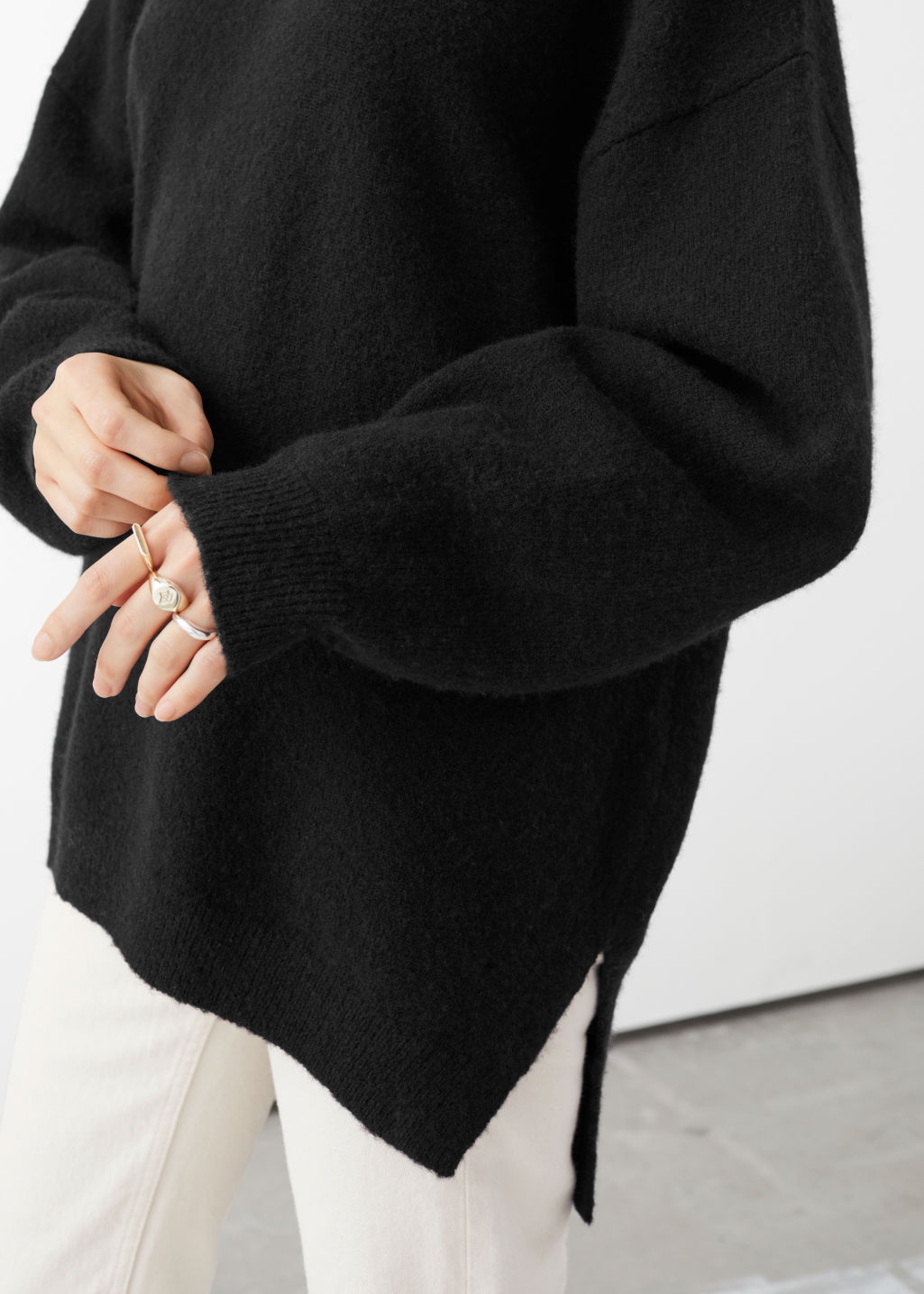 Model front image of Stories wool sweater in black