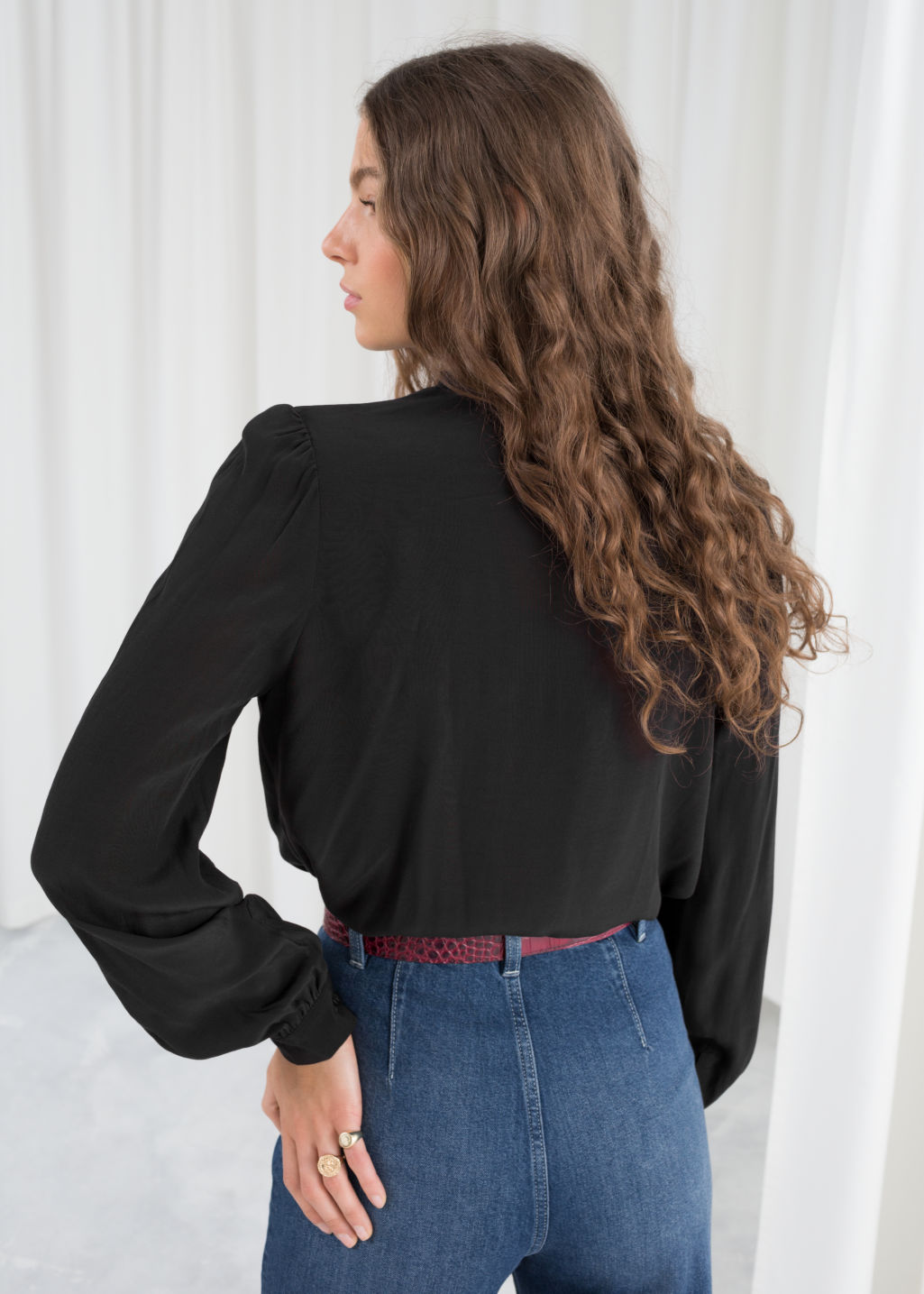 Model back image of Stories lace panel blouse in black