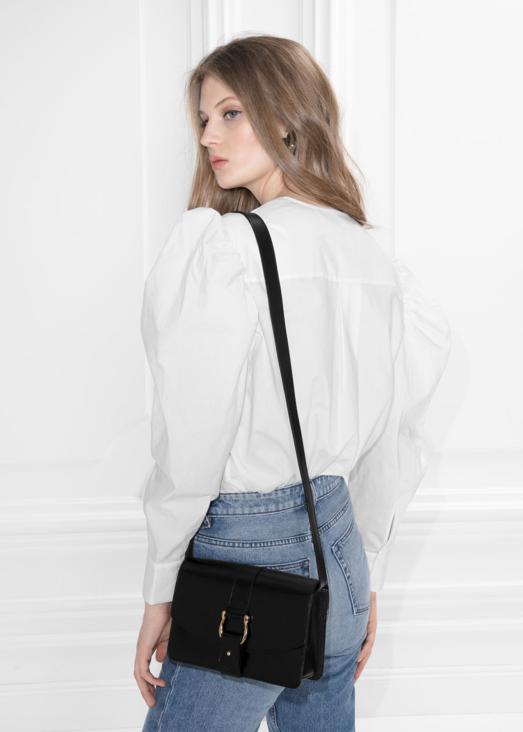 Model back image of Stories shoulder puff blouse in white