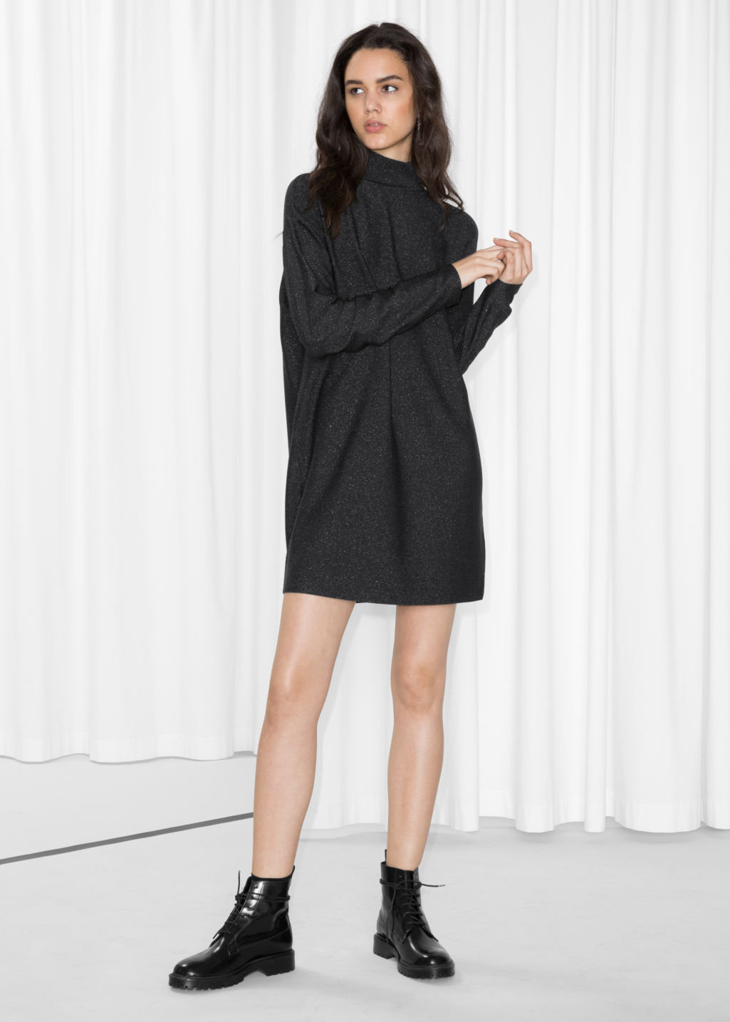 Model back image of Stories mock neck dress in black