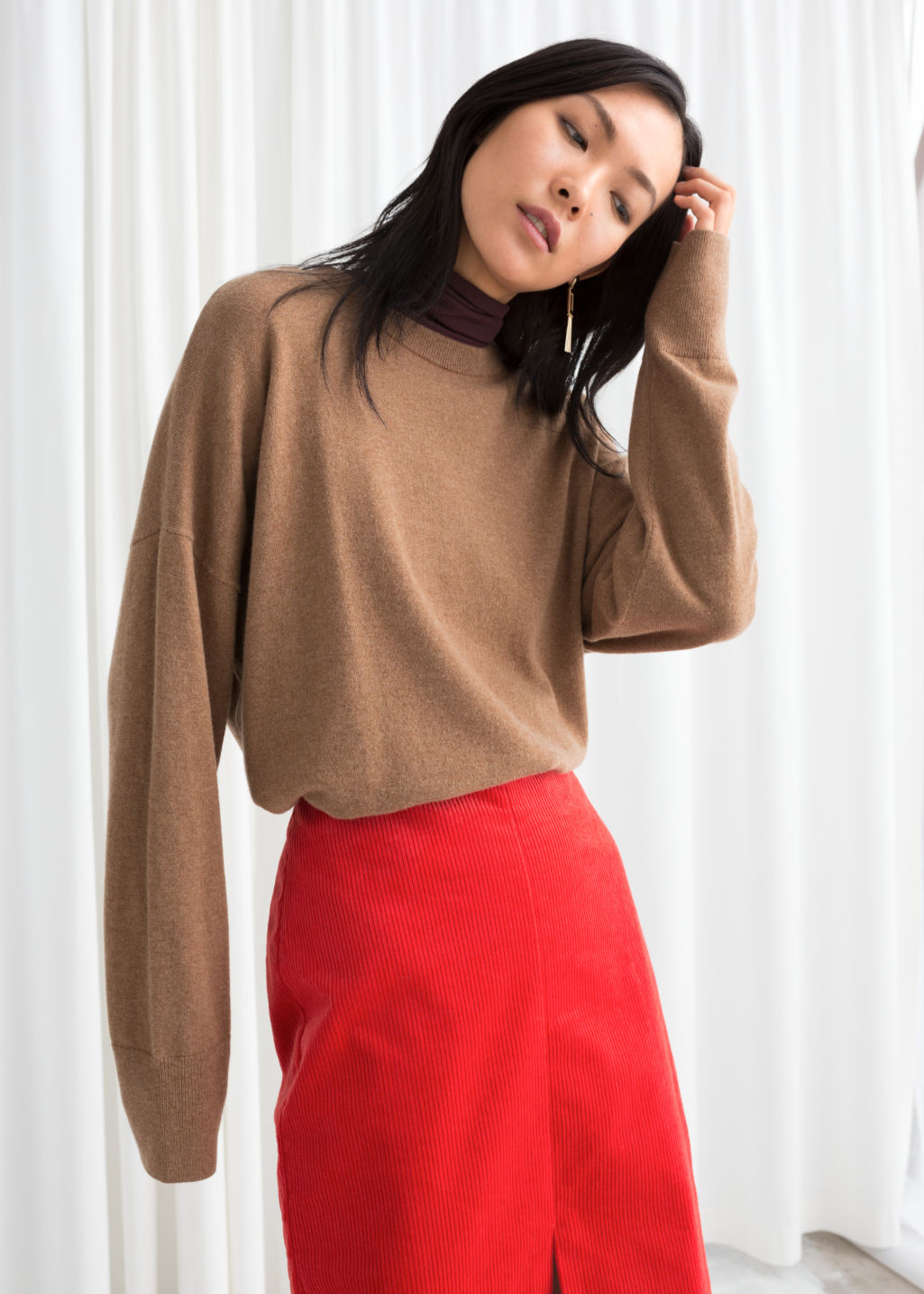 Model front image of Stories cashmere sweater in beige