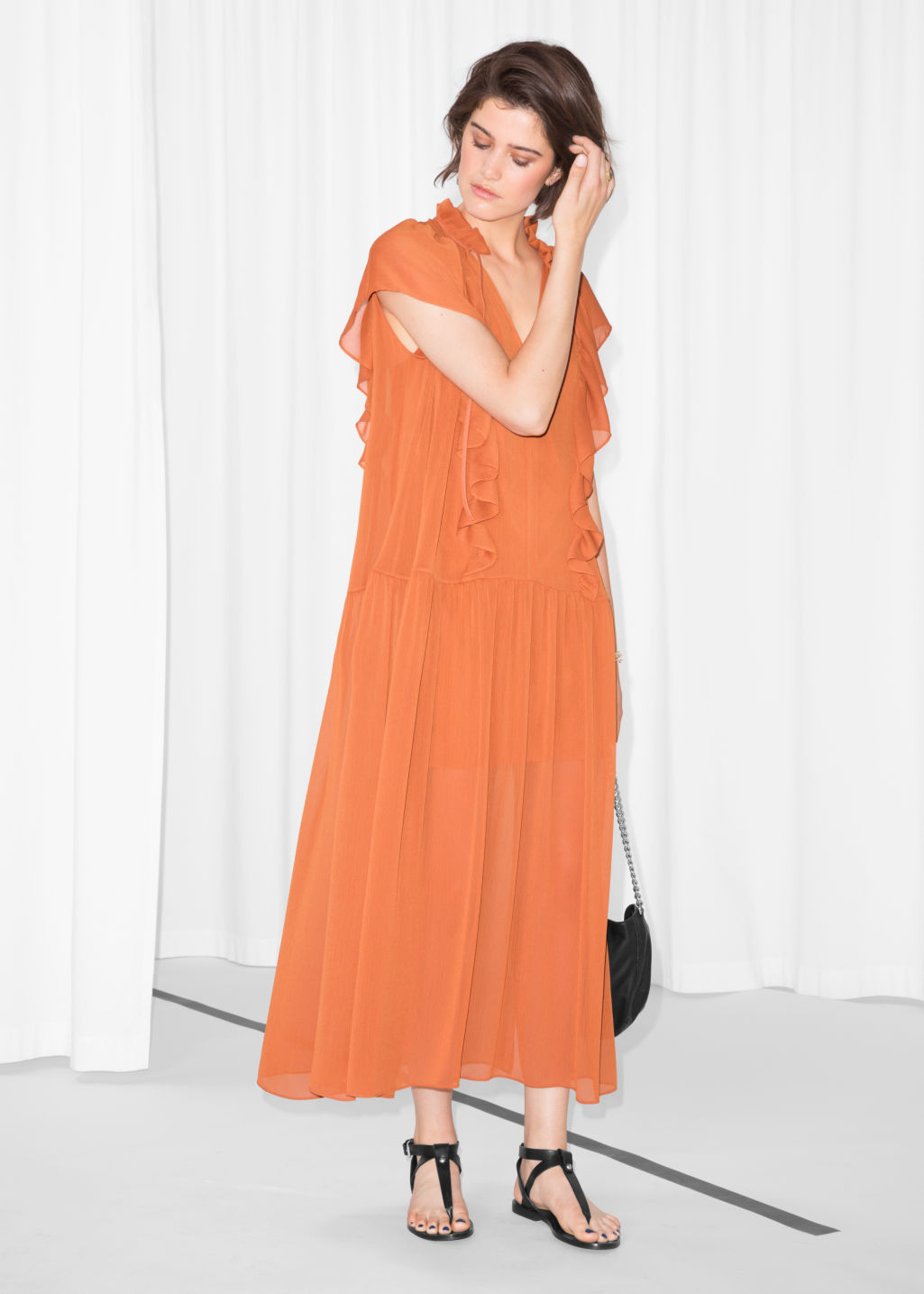 Model front image of Stories oversized frill dress in orange