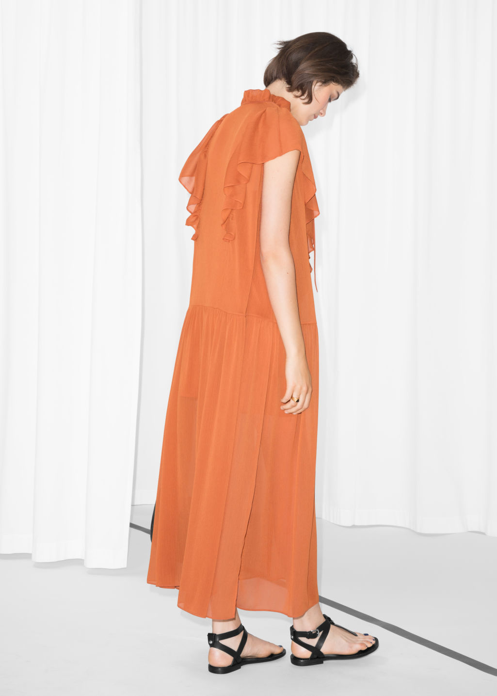 Model back image of Stories oversized frill dress in orange