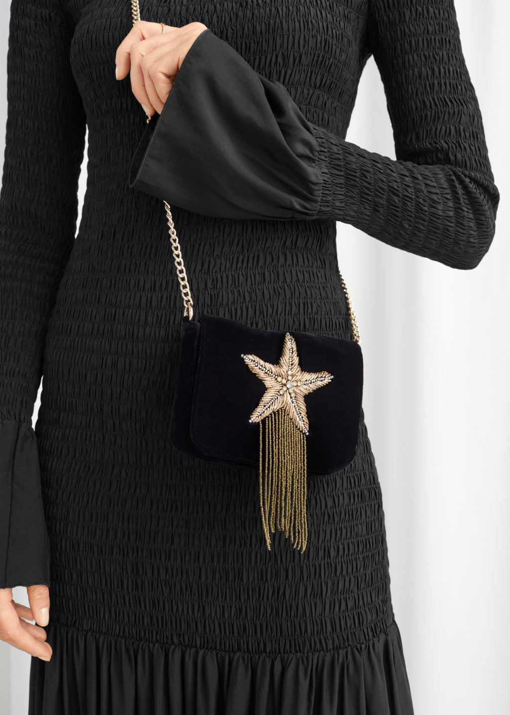 Model front image of Stories beaded velvet crossbody bag in black